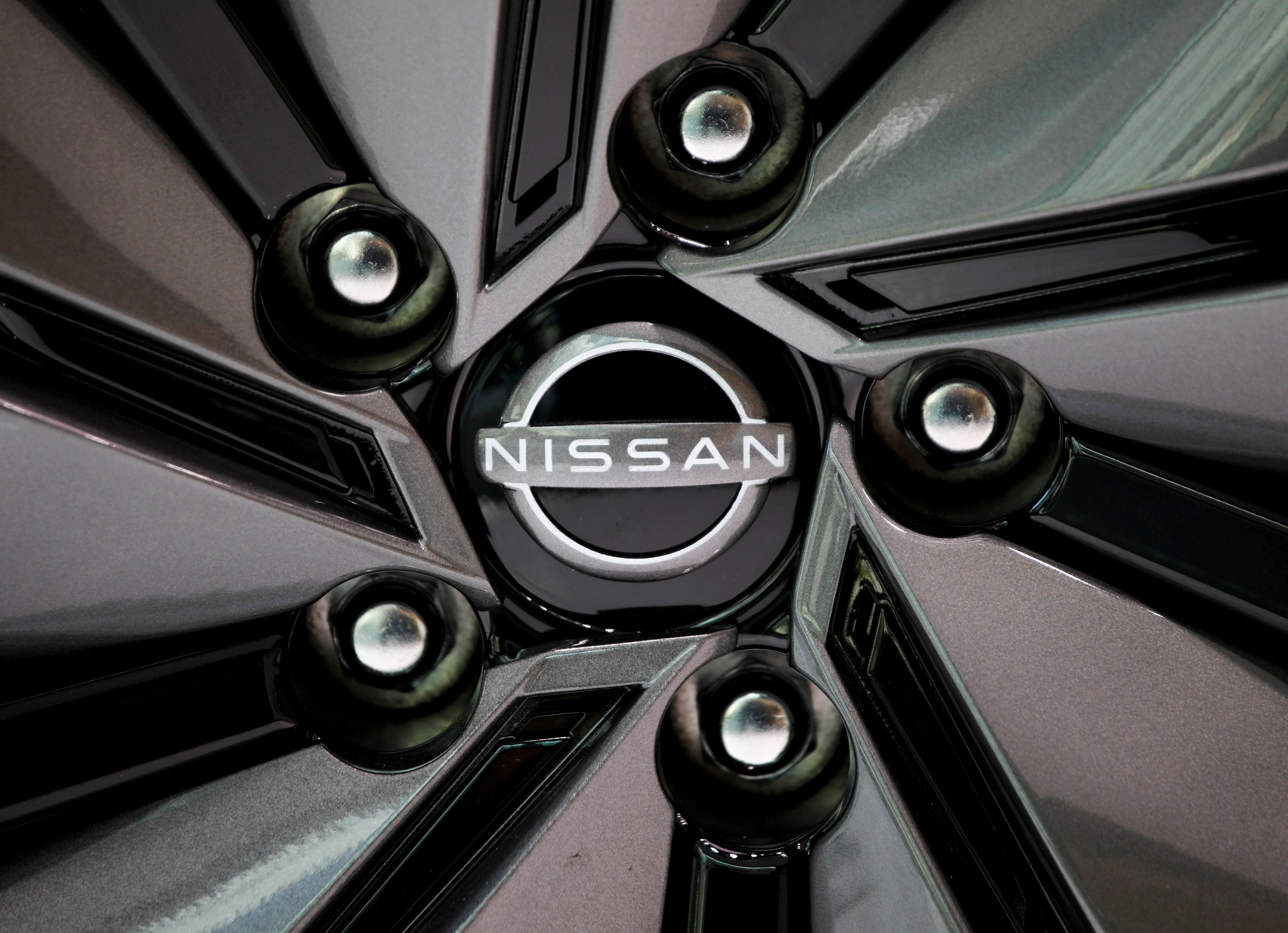 FILE PHOTO: The brand logo of Nissan Motor Corp. is seen on a tyre wheel of the company's car at their showroom in Tokyo, Japan November 11, 2020.  REUTERS/Issei Kato