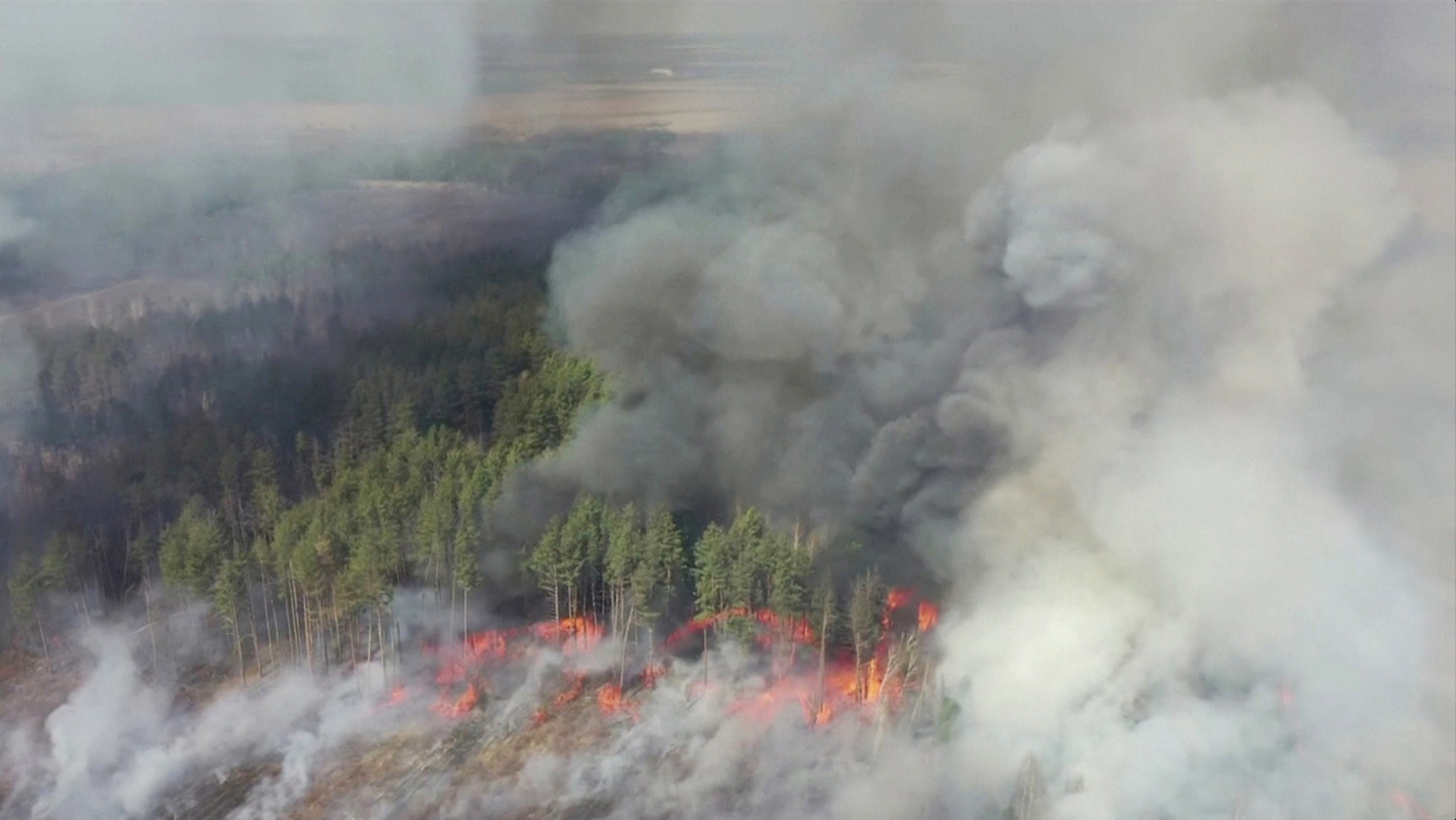 An aerial view shows a forest fire in the 30 km (19 miles) exclusion zone around the Chernobyl nuclear power plant, Ukraine, April 12, 2020.