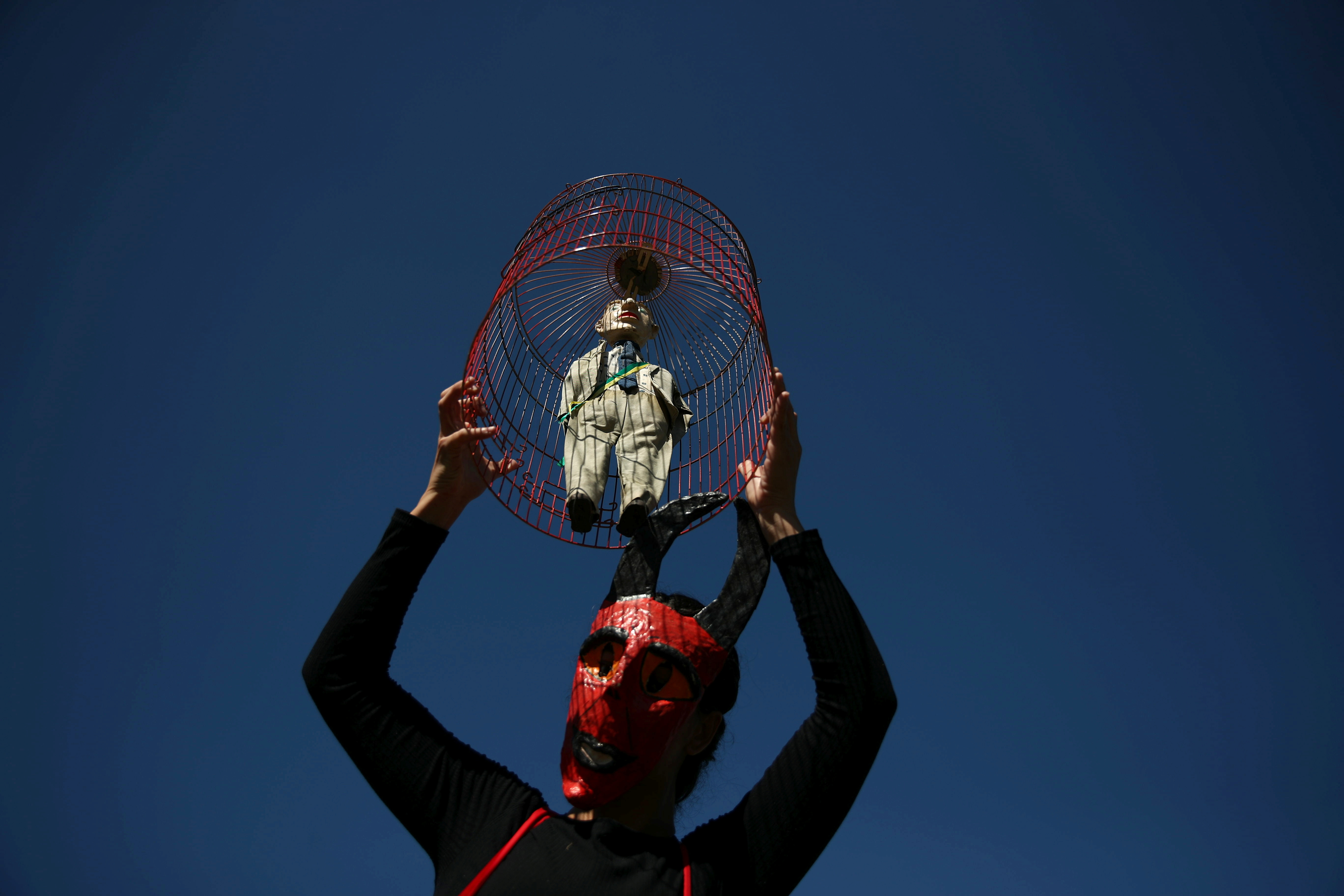 A protestor holds a puppet depicting Brazil's President Jair Bolsonaro during a demonstration against his handling of the coronavirus disease (COVID-19) pandemic and demanding his impeachment, in Rio de Janeiro, Brazil, July 24, 2021. REUTERS/Ricardo Moraes