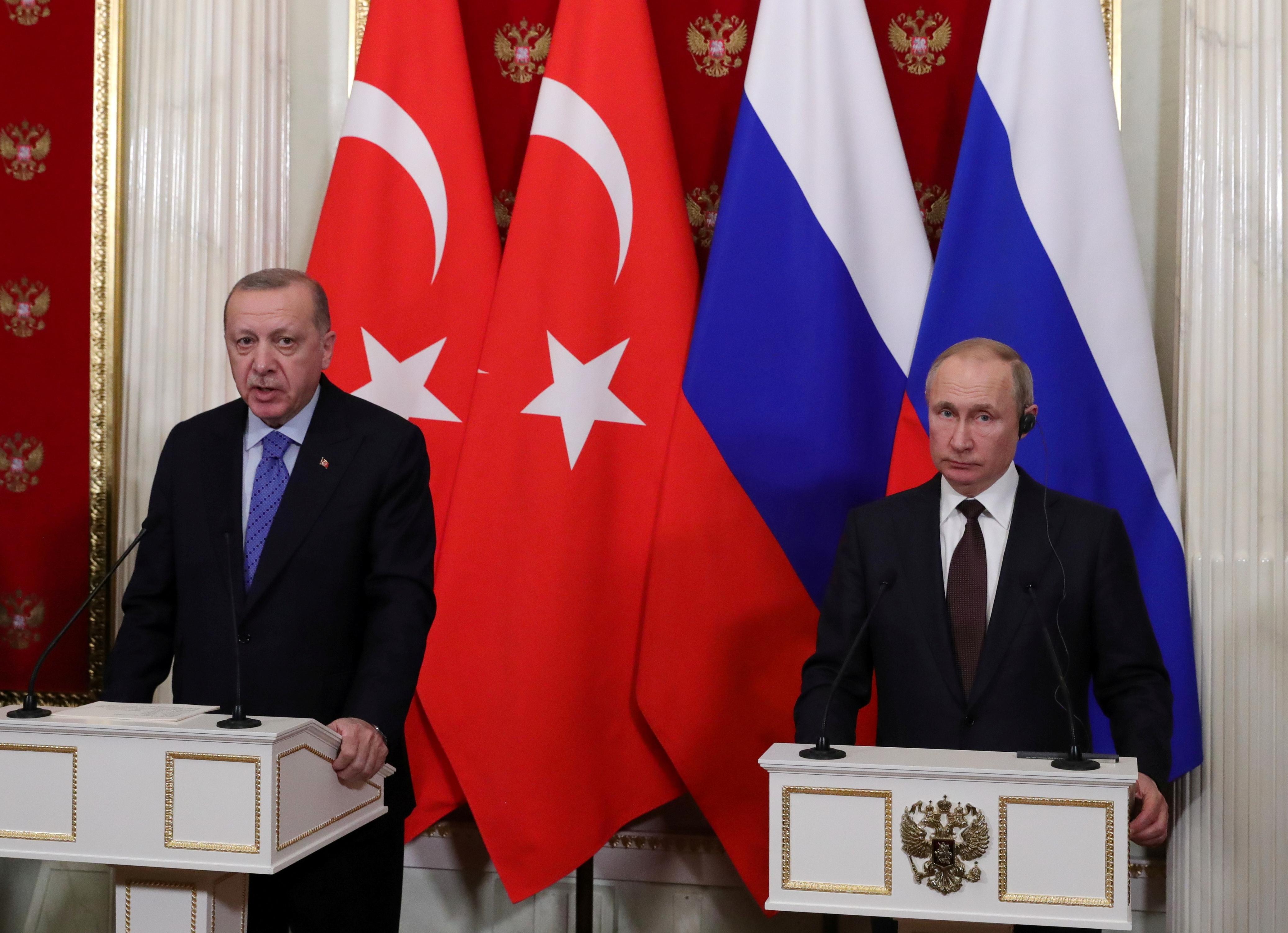 Russian President Vladimir Putin and Turkish President Tayyip Erdogan attend a news conference following their talks in Moscow, Russia March 5, 2020. Sputnik/Mikhail Klimentyev/Kremlin via REUTERS