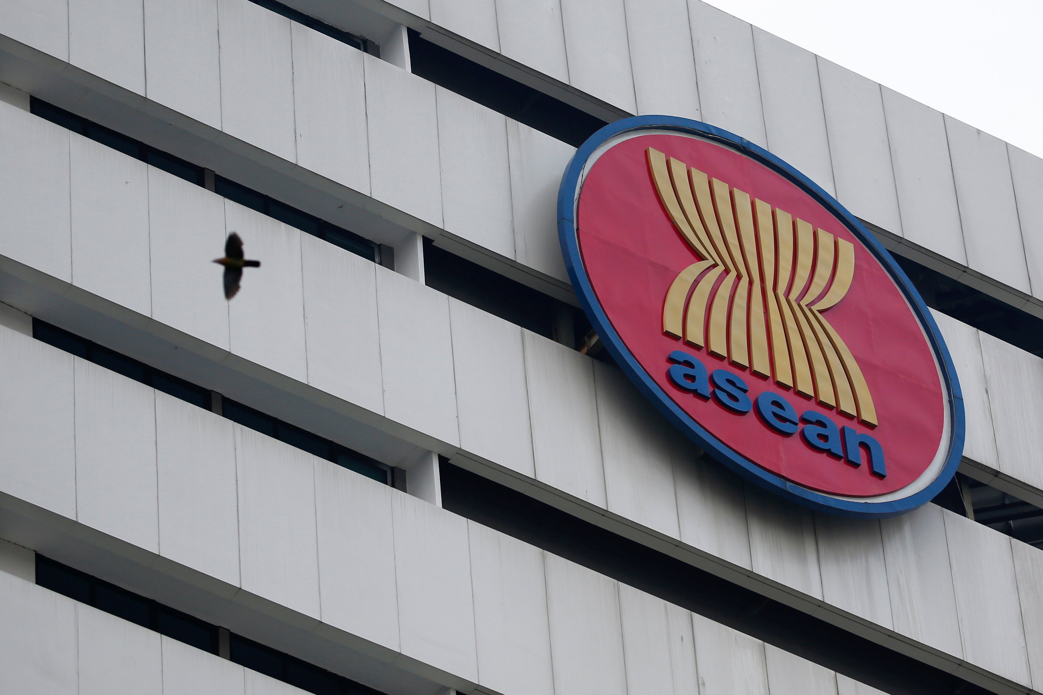 A bird flies near the Association of Southeast Asian Nations (ASEAN) secretariat building, ahead of the ASEAN leaders' meeting in Jakarta, Indonesia, April 23, 2021. REUTERS/Willy Kurniawan