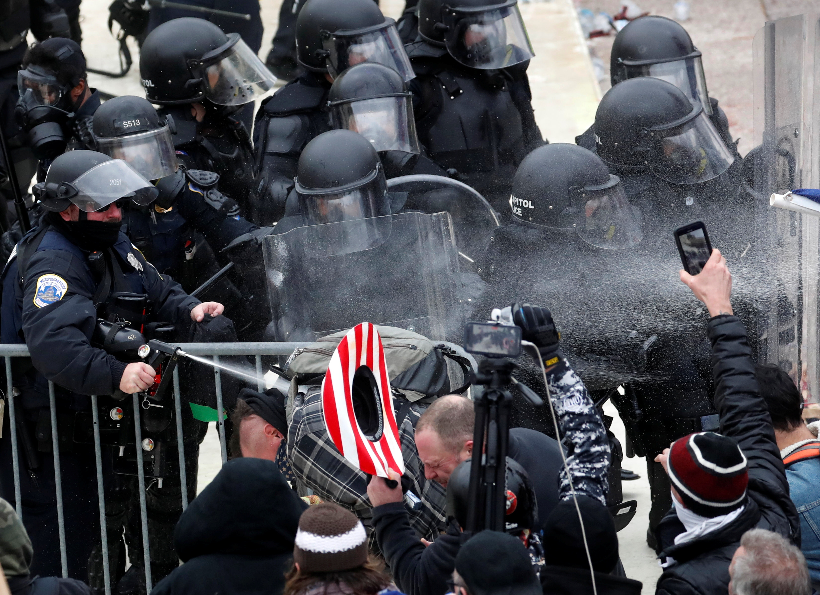 Police officers release pepper spray on pro-Trump protesters during clashes with Capitol police at a rally to contest the certification of the 2020 U.S. presidential election results by the U.S. Congress, at the U.S. Capitol Building in Washington, U.S, January 6, 2021. REUTERS/Shannon Stapleton