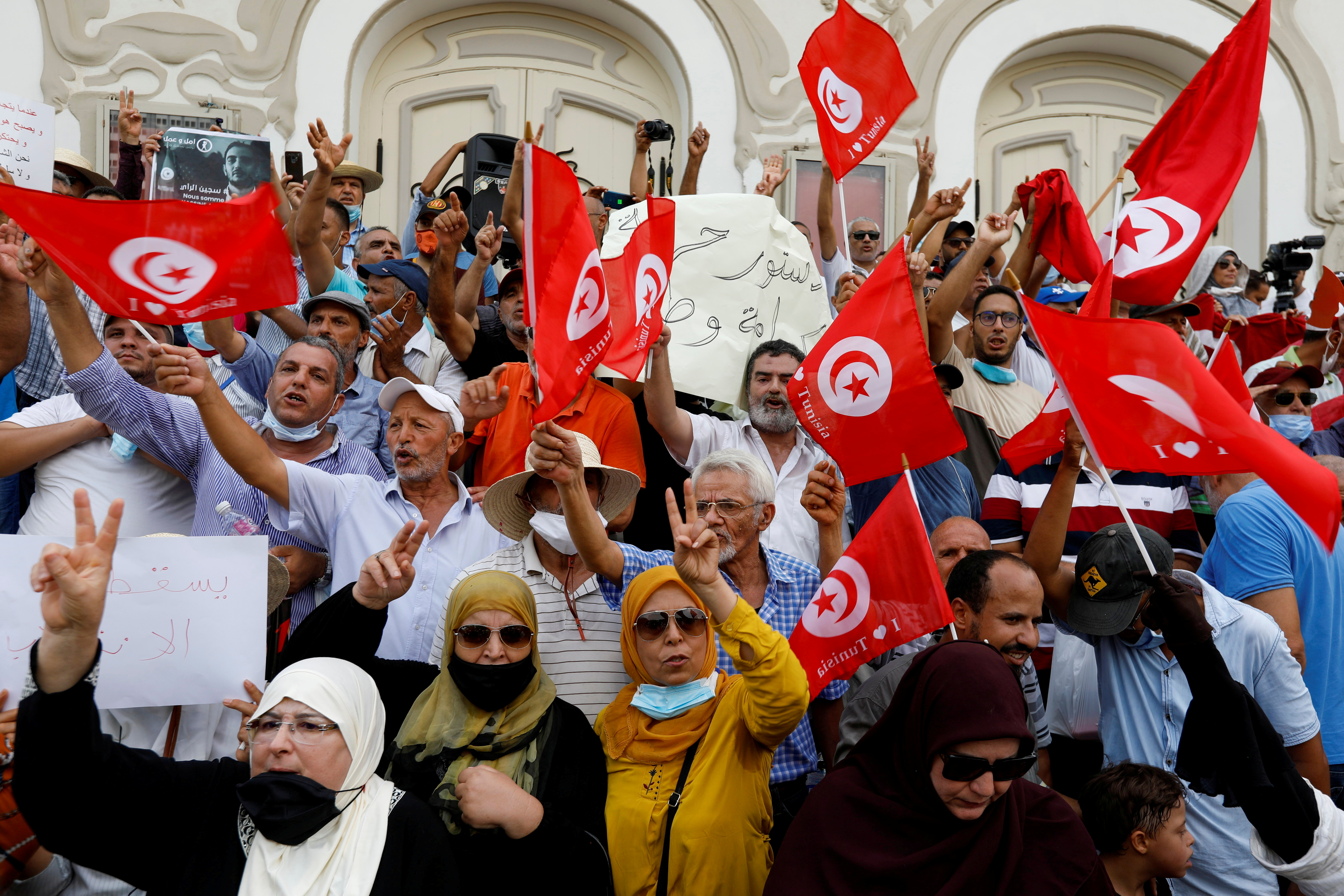 Opponents of Tunisia's President Kais Saied take part in a protest against what they call his coup on July 25, in Tunis, Tunisia September 18, 2021. REUTERS/Zoubeir Souissi/File Photo