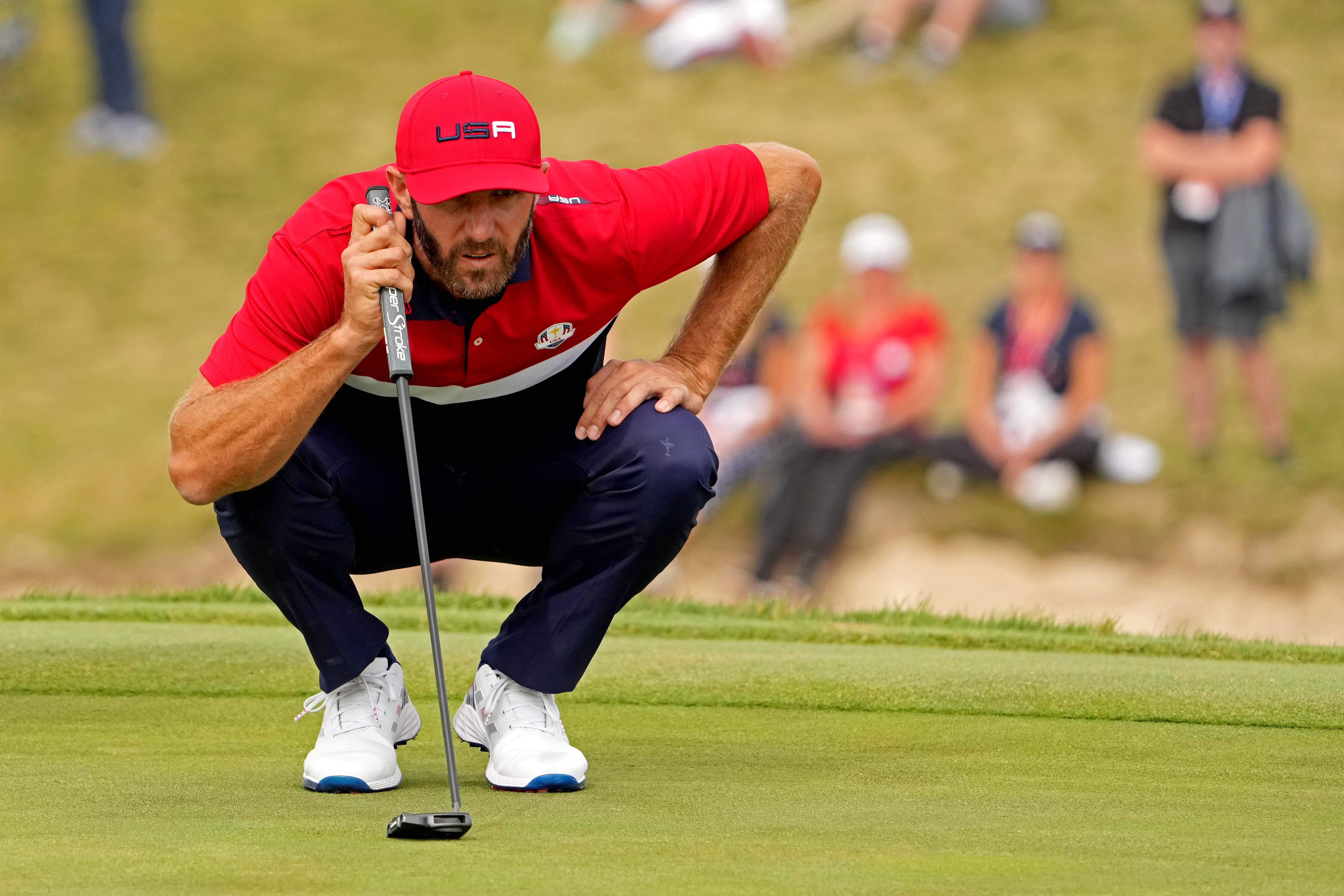 Sep 26, 2021; Haven, Wisconsin, USA; Team USA player Dustin Johnson lines up his putt on the first hole during day two four-ball rounds for the 43rd Ryder Cup golf competition at Whistling Straits. Mandatory Credit: Kyle Terada-USA TODAY Sports