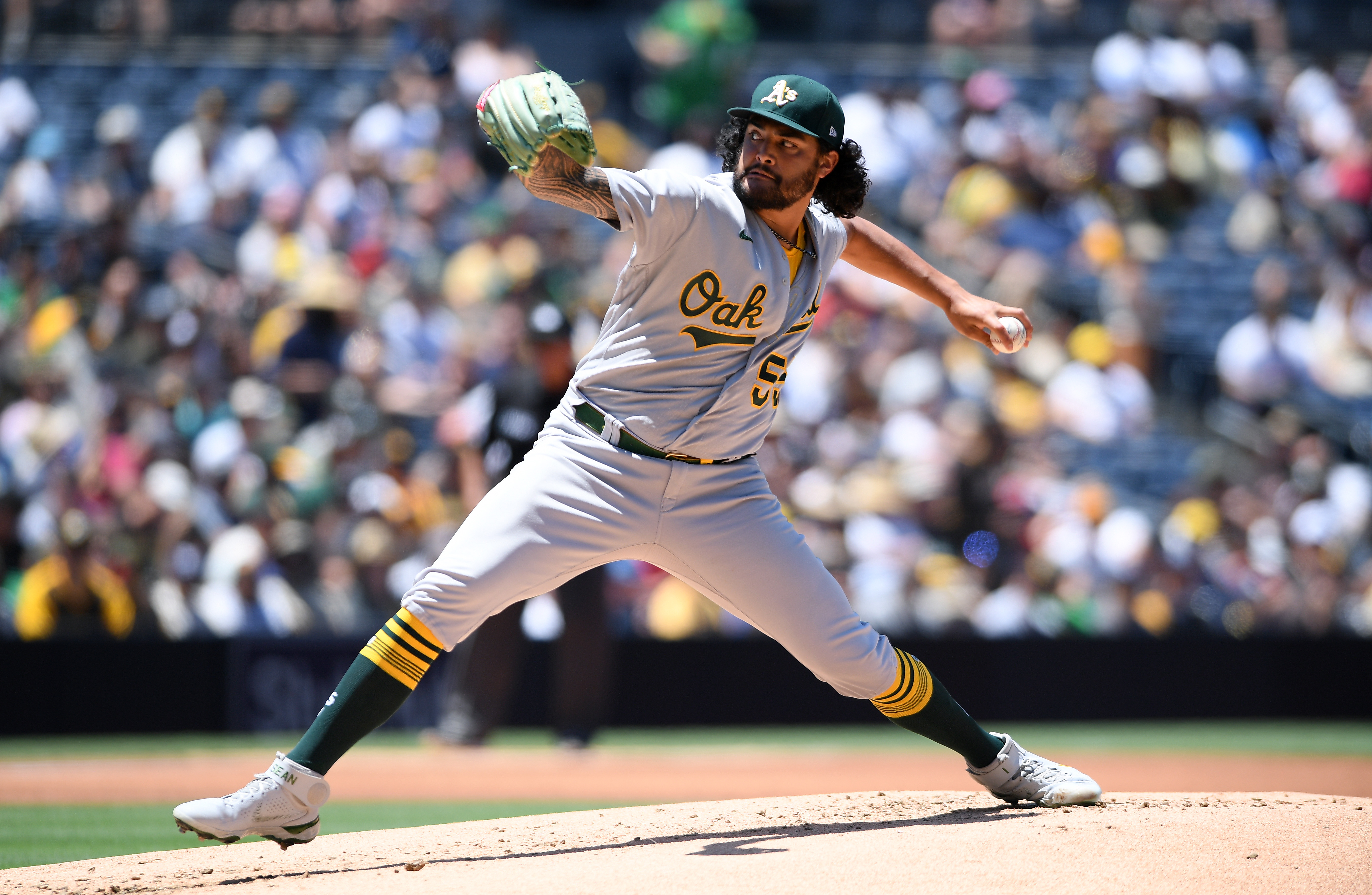 Jul 28, 2021; San Diego, California, USA; Oakland Athletics starting pitcher Sean Manaea (55) throws a pitch against the San Diego Padres during the first inning at Petco Park. Mandatory Credit: Orlando Ramirez-USA TODAY Sports