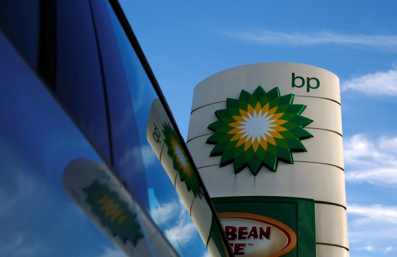 A BP logo is reflected in a car window at a petrol station in London January 15, 2015. REUTERS/Luke MacGregor/File Photo