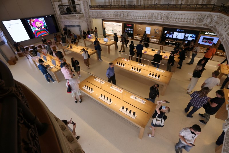 Customers browse products at the new Apple Store on Broadway in downtown Los Angeles, California, U.S., June 24, 2021. REUTERS/Lucy Nicholson/File Photo