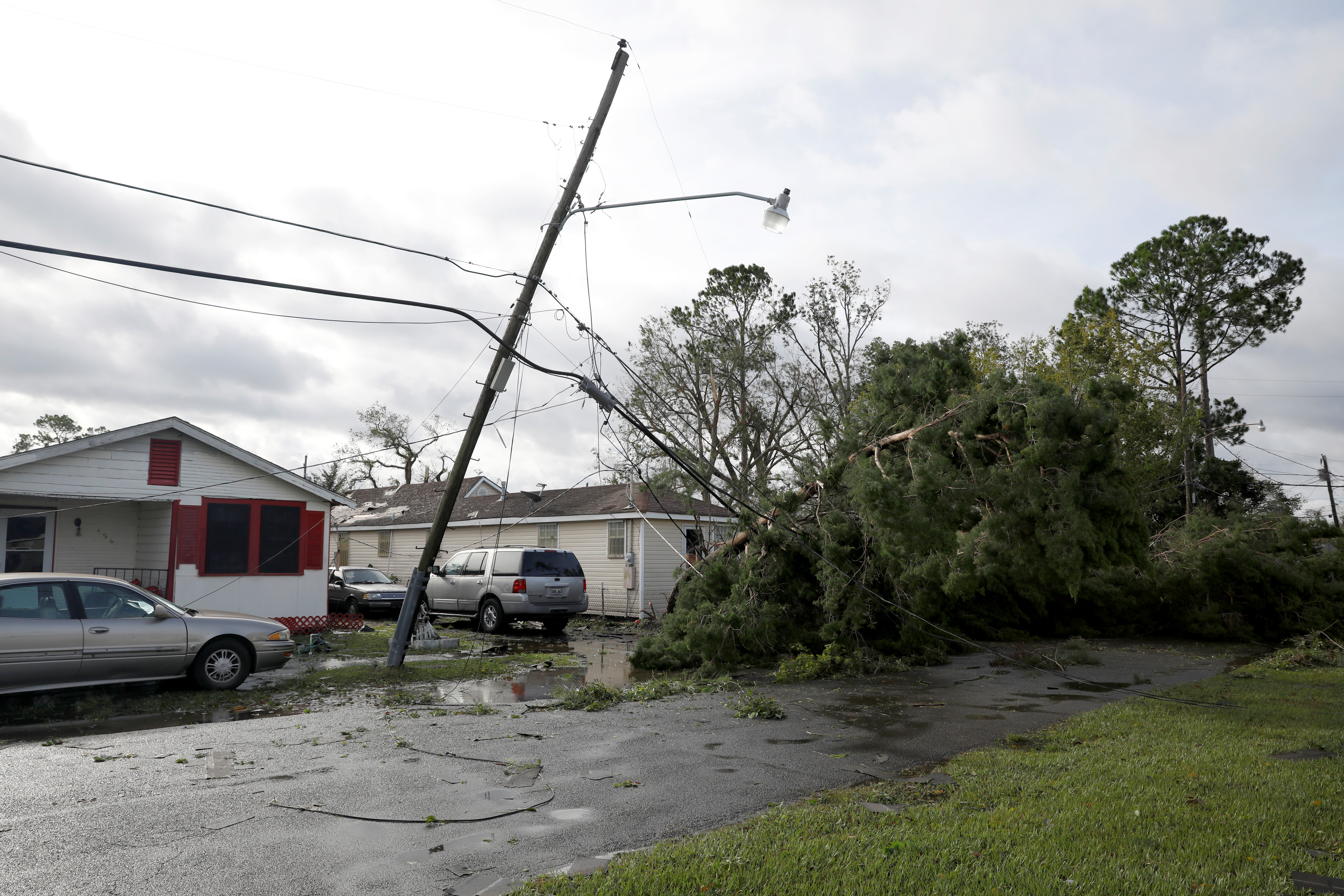 A damaged electric line is pictured after Hurricane Ida made landfall in Louisiana, in Kenner, Louisiana, U.S. August 30, 2021. REUTERS/Marco Bello