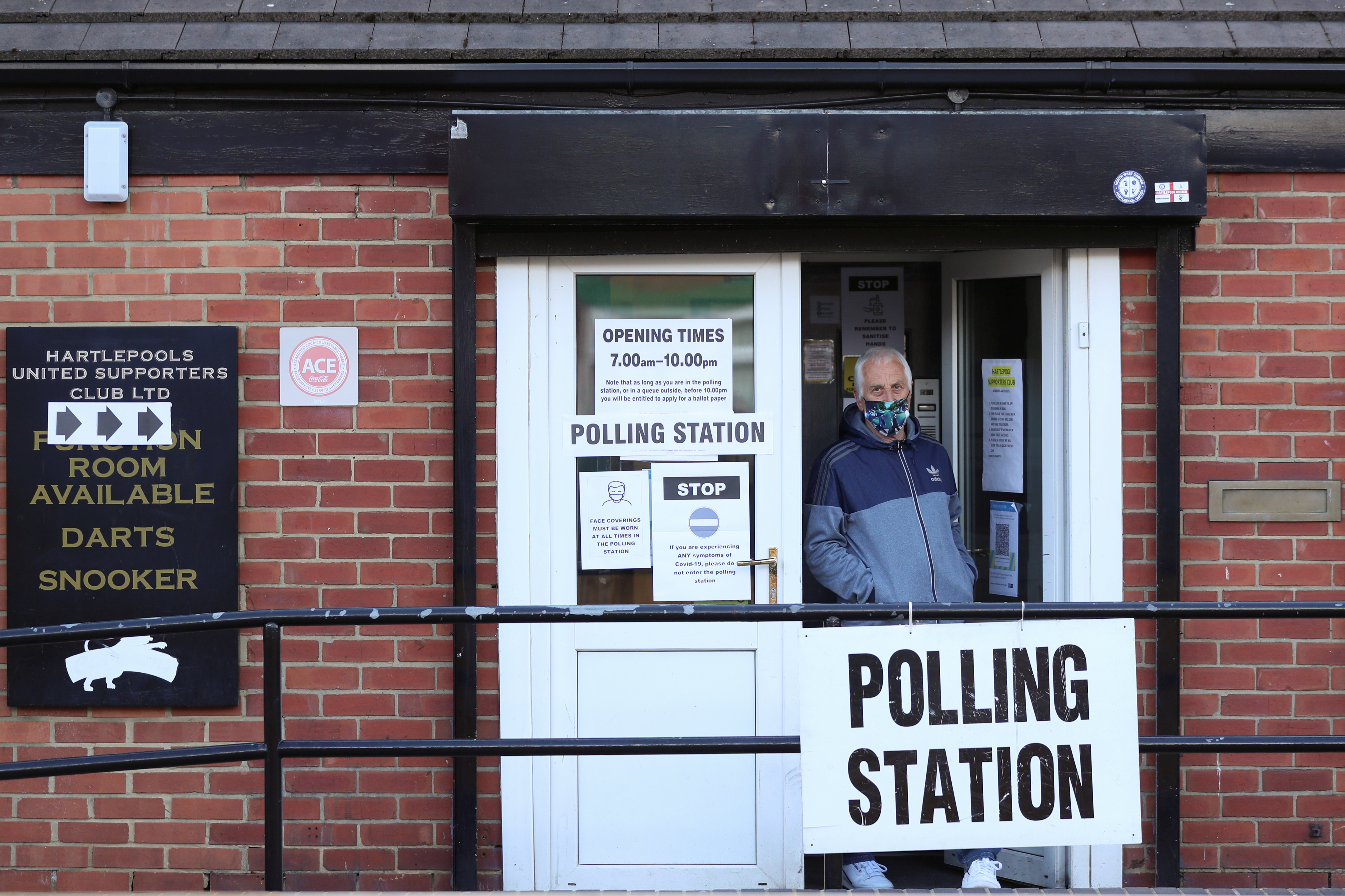 A man is seen at a polling station during local elections, in Hartlepool, Britain May 6, 2021. REUTERS/Lee Smith