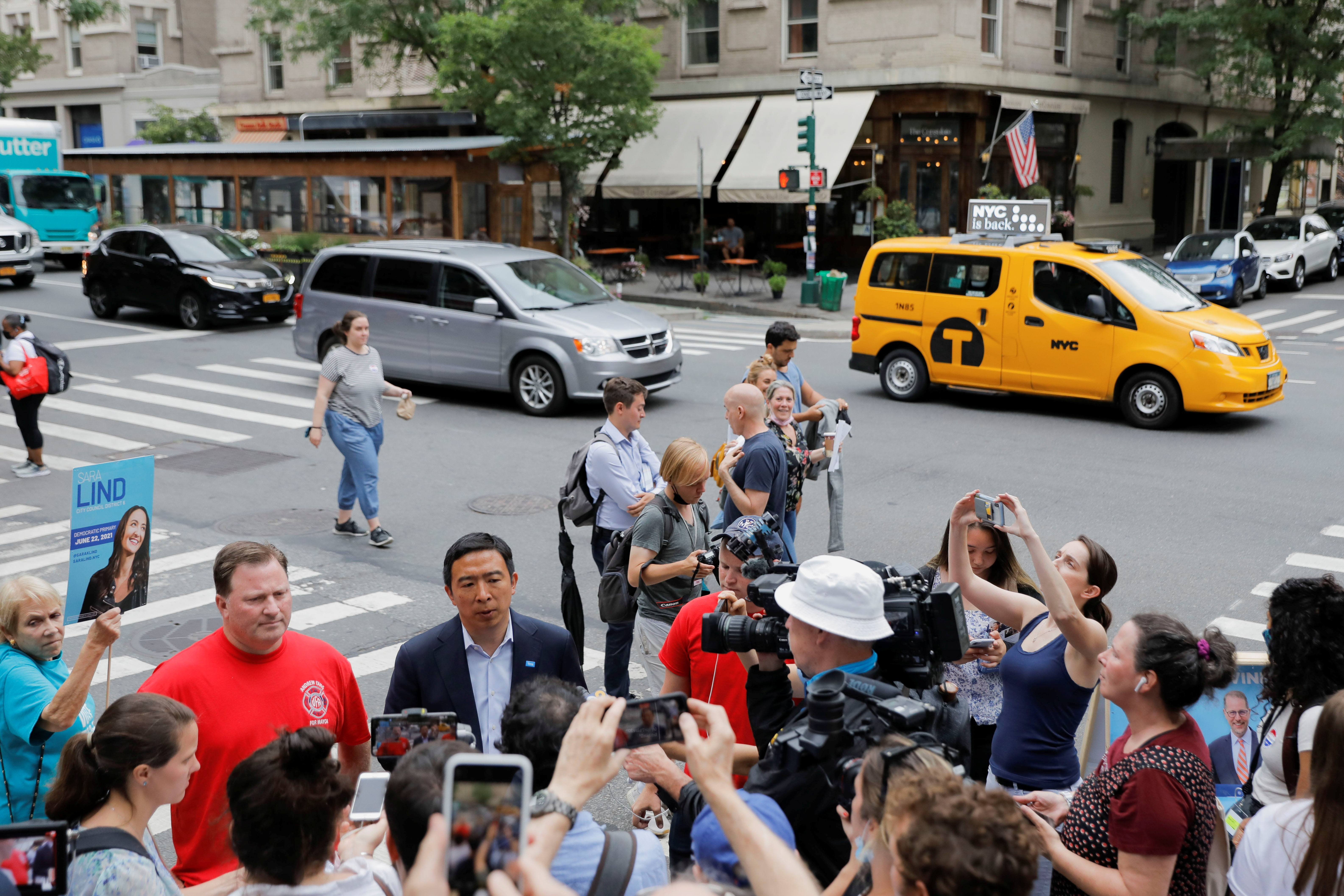 Democratic New York City Mayoral candidate Andrew Yang speaks to the media, during the New York City primary mayoral election, in New York City, U.S., June 22, 2021. REUTERS/Andrew Kelly