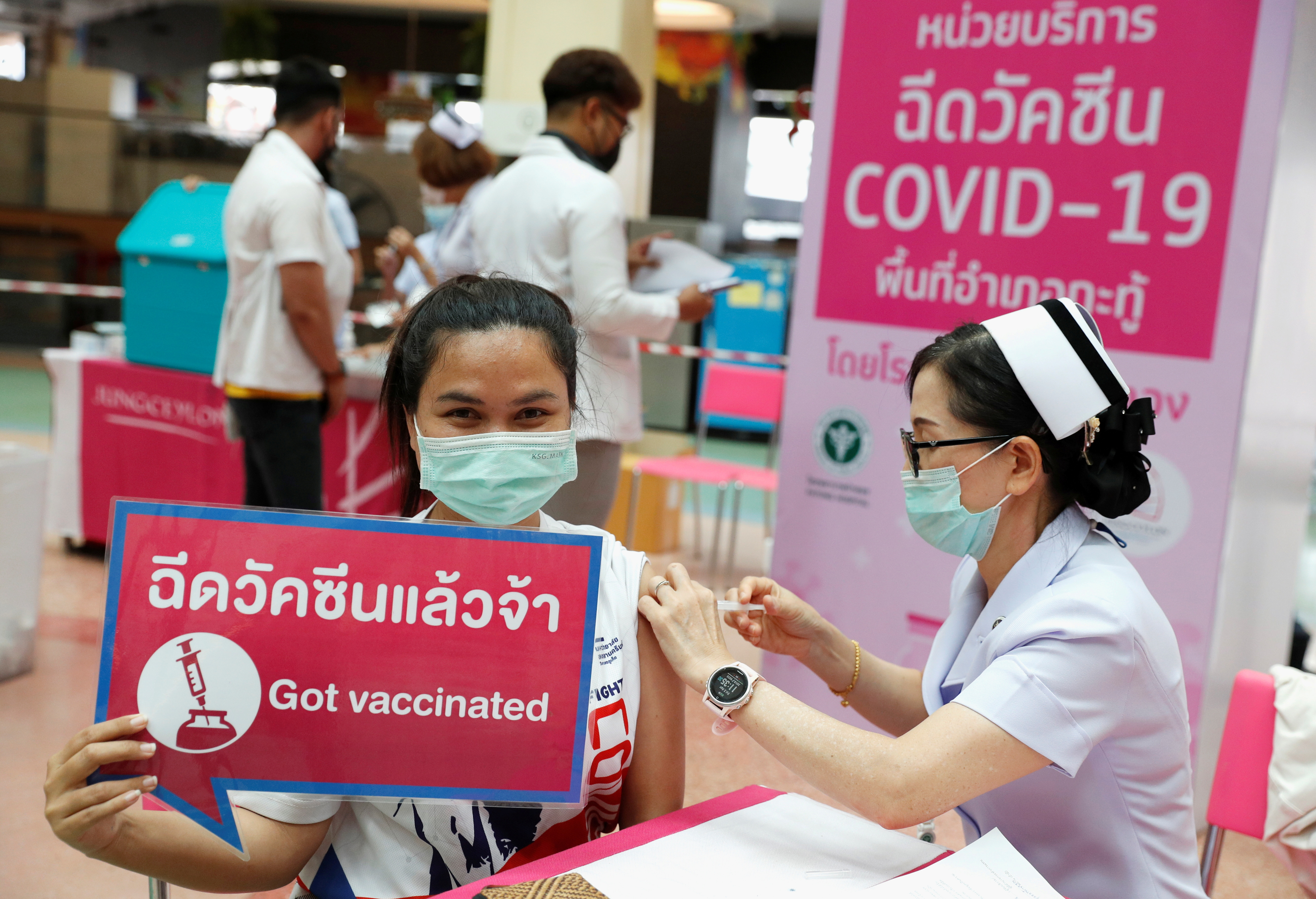 People receive the Sinovac COVID-19 vaccine as the Thai resort island of Phuket rushes to vaccinate its population amid the coronavirus disease (COVID-19) outbreak, and ahead of a July 1 ending of strict quarantine for overseas visitors, to bring back tourism revenue in Phuket, Thailand, April 2, 2021. REUTERS/Jorge Silva