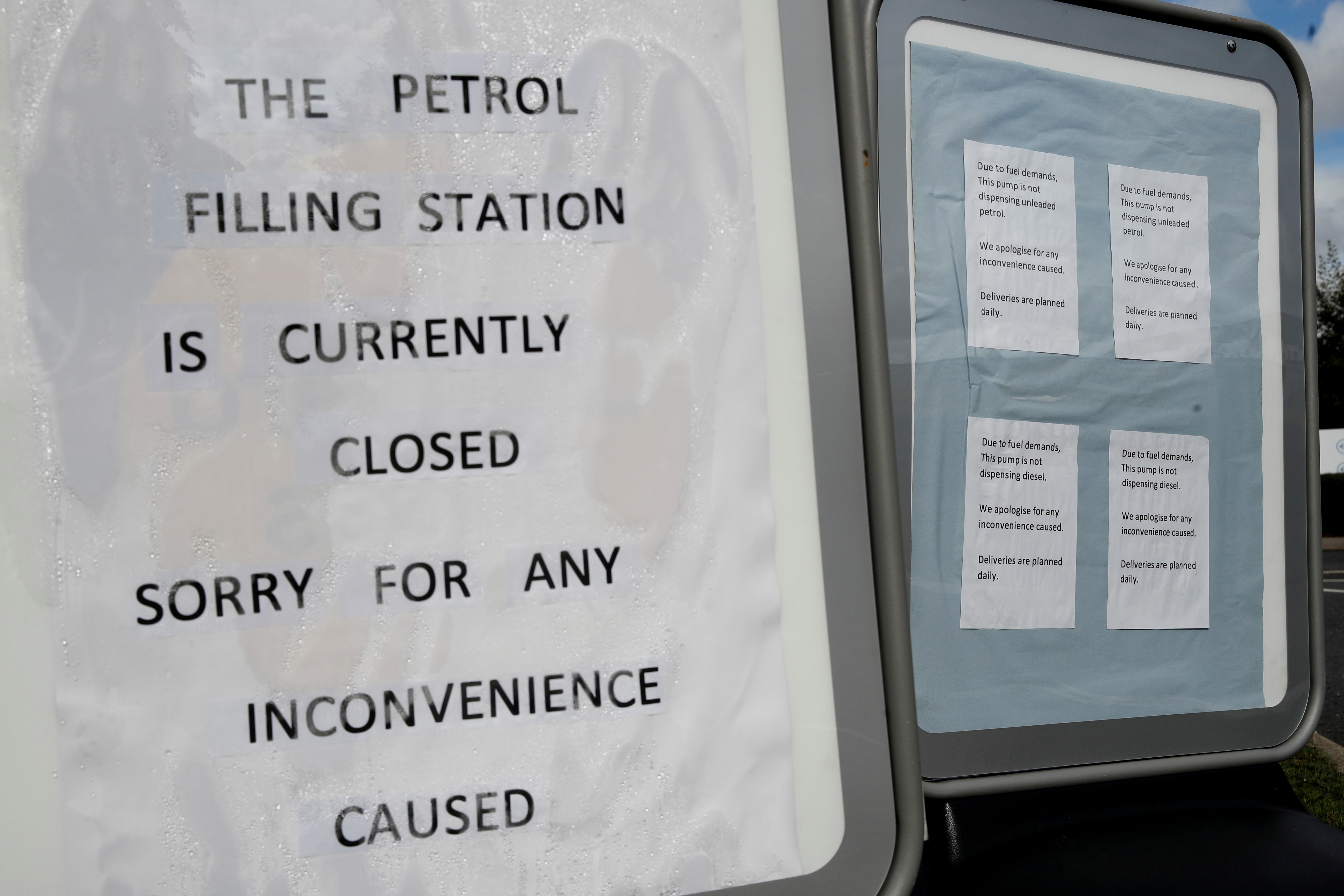 Signs outside a Tesco petrol station that has run out of fuel, are pictured in Hemel Hempstead, Britain, October 4, 2021. REUTERS/Paul Childs/File Photo