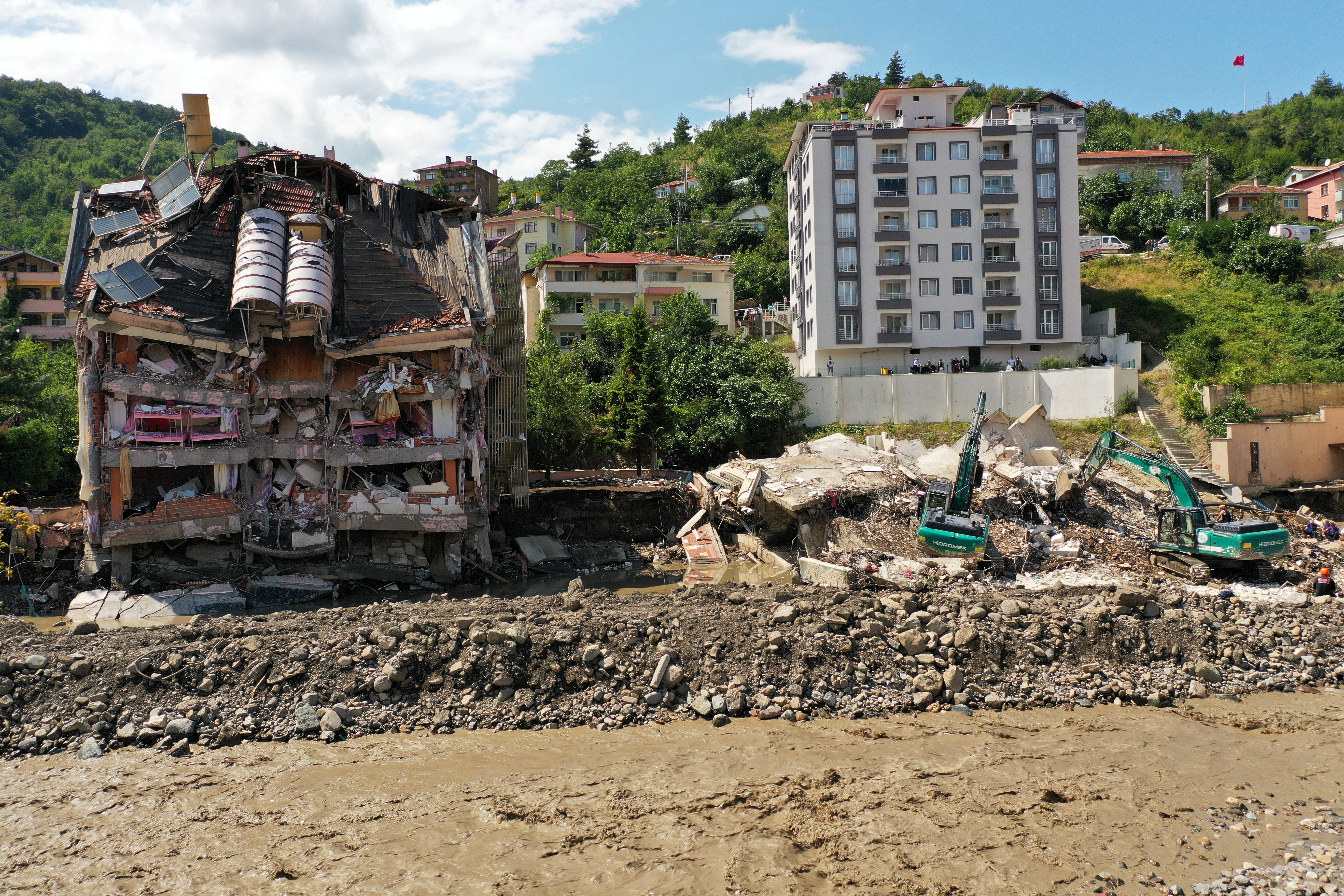 A view shows a partially collapsed building, as the area was hit by flash floods that swept through towns in the Turkish Black Sea region, in the town of Bozkurt, in Kastamonu province, Turkey, August 14, 2021. Picture taken with a drone. REUTERS/Mehmet Emin Caliskan