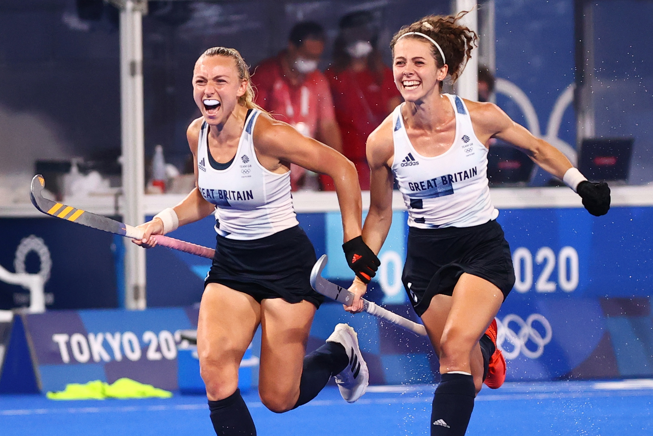 Tokyo 2020 Olympics - Hockey - Women - Quarterfinal - Spain v Britain - Oi Hockey Stadium, Tokyo, Japan - August 2, 2021. Players of Britain celebrate after winning their match by penalty shoot-out. REUTERS/Kim Hong-Ji