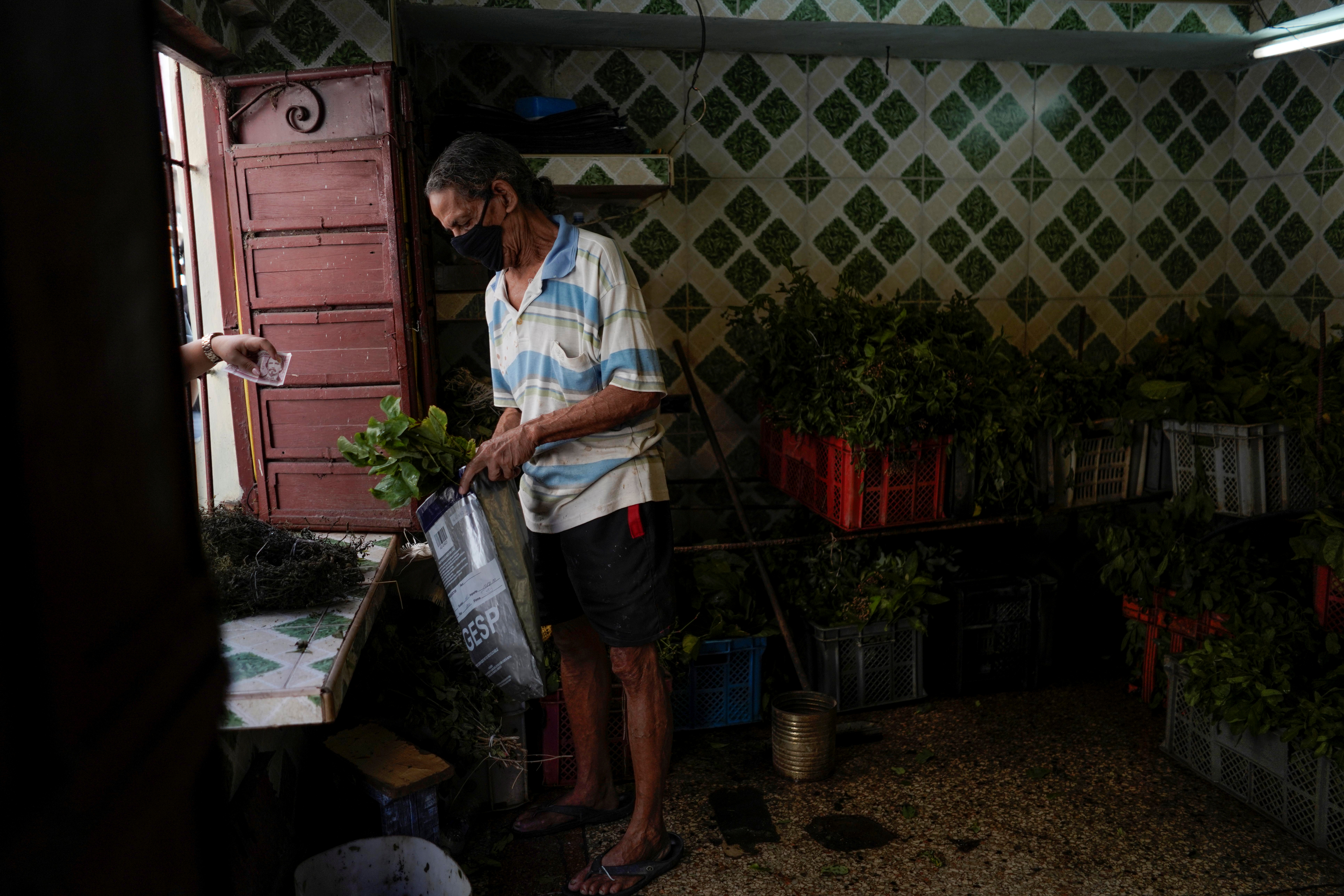 Florencio Chavez sells herbs for medicine in downtown Havana, Cuba, March 30, 2021. Picture taken on March 30, 2021. REUTERS/Alexandre Meneghini