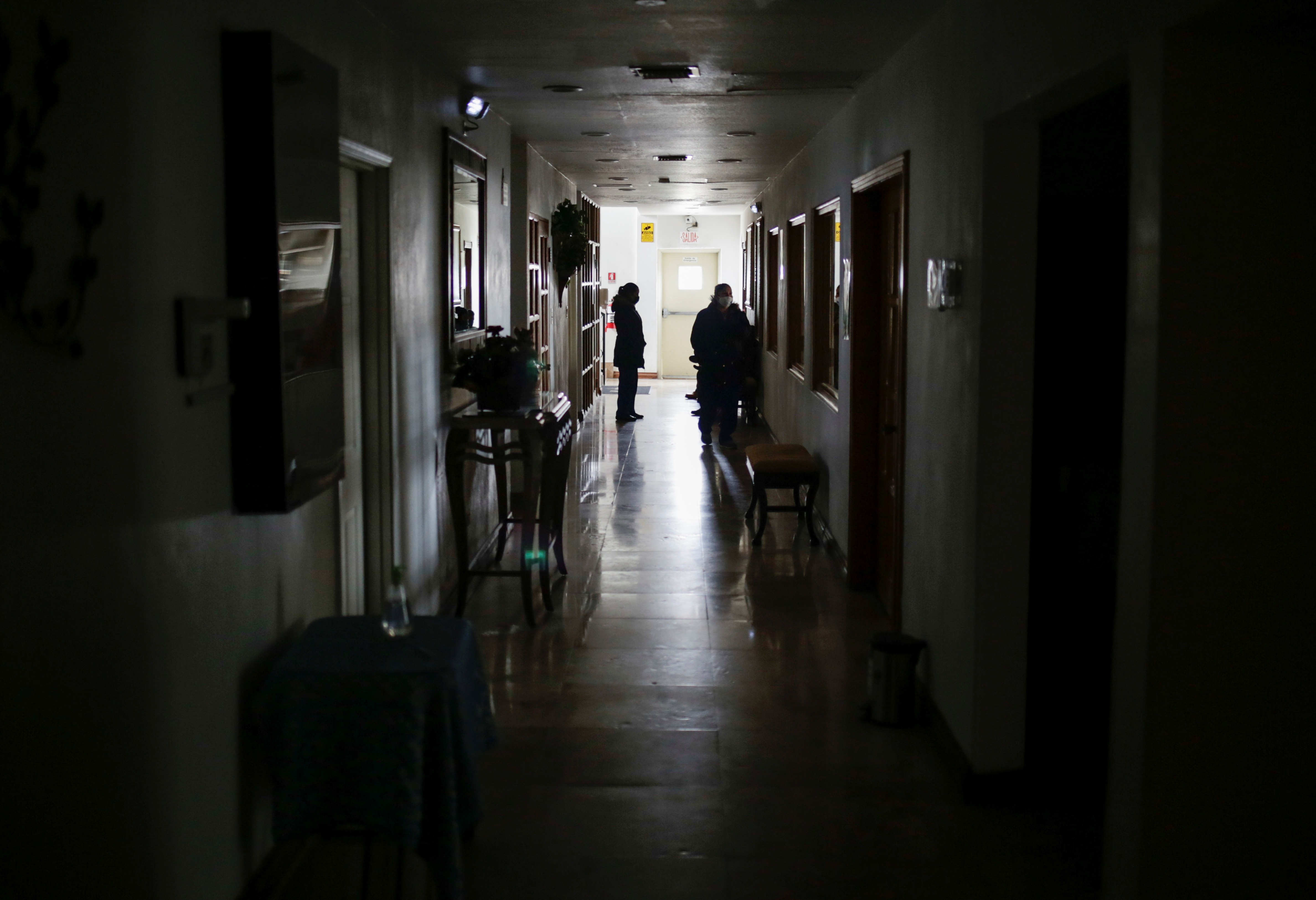 People wait in a corridor during an outage in Mexico's electricity network, in Ciudad Juarez, Mexico February 15, 2021. REUTERS/Jose Luis Gonzalez