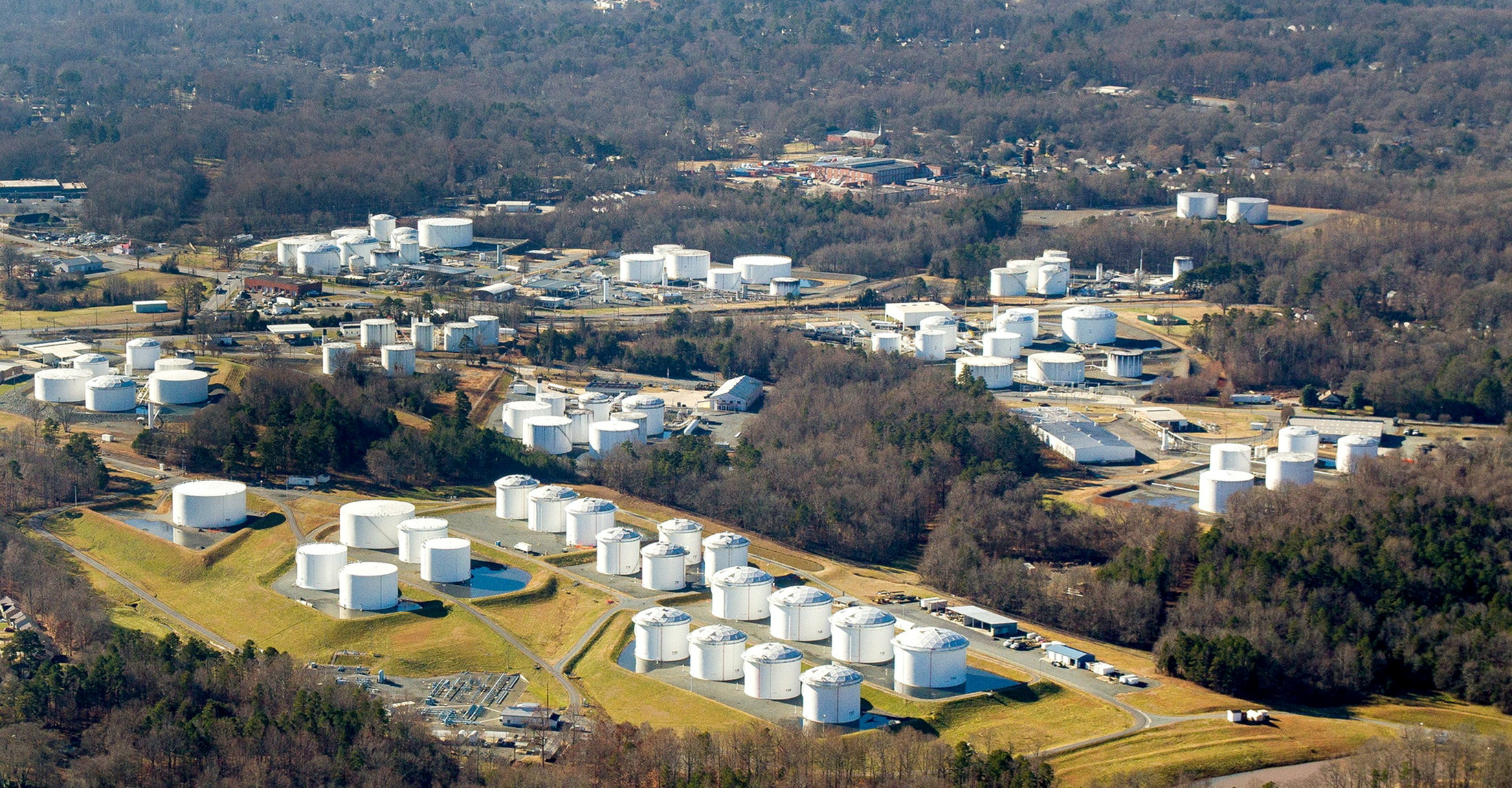 Holding tanks are seen at Colonial Pipeline's Charlotte Tank Farm in Charlotte, North Carolina, U.S. in an undated photograph.  Colonial Pipeline/Handout via REUTERS.