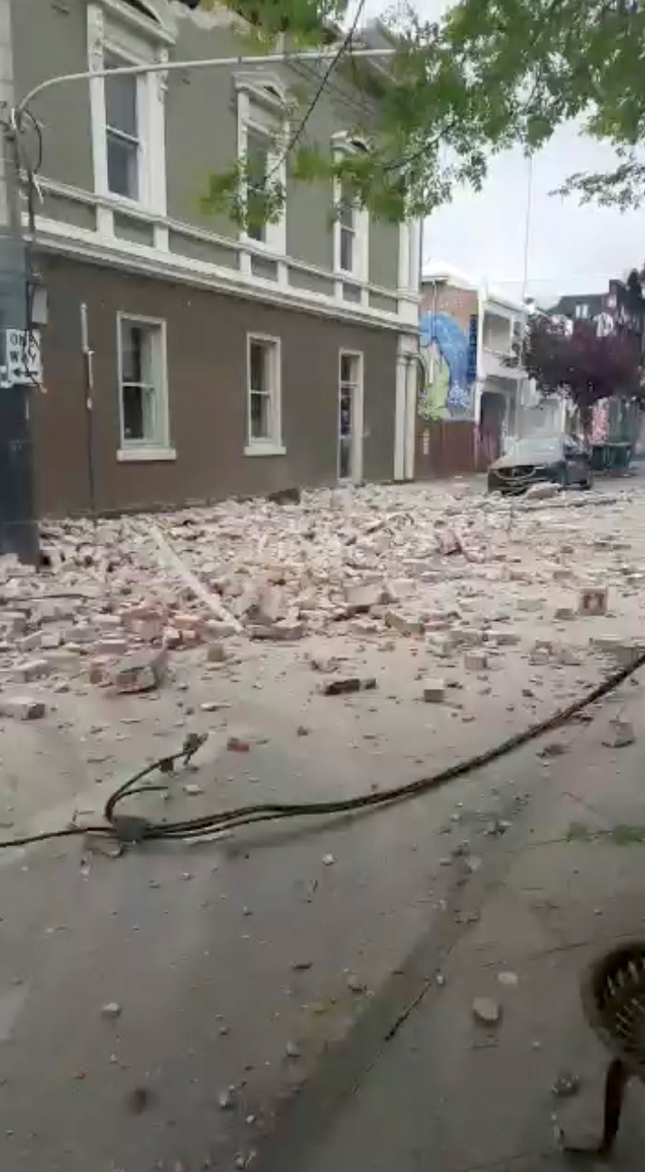 Debris are seen on a road in Prahran, after a magnitude 6.0 earthquake struck near Melbourne, Victoria, Australia, September 22, 2021, in this still image from video obtained via social media. Tom Robertson via REUTERS  ATTENTION EDITORS - THIS IMAGE HAS BEEN SUPPLIED BY A THIRD PARTY. MANDATORY CREDIT. NO RESALES. NO ARCHIVES.