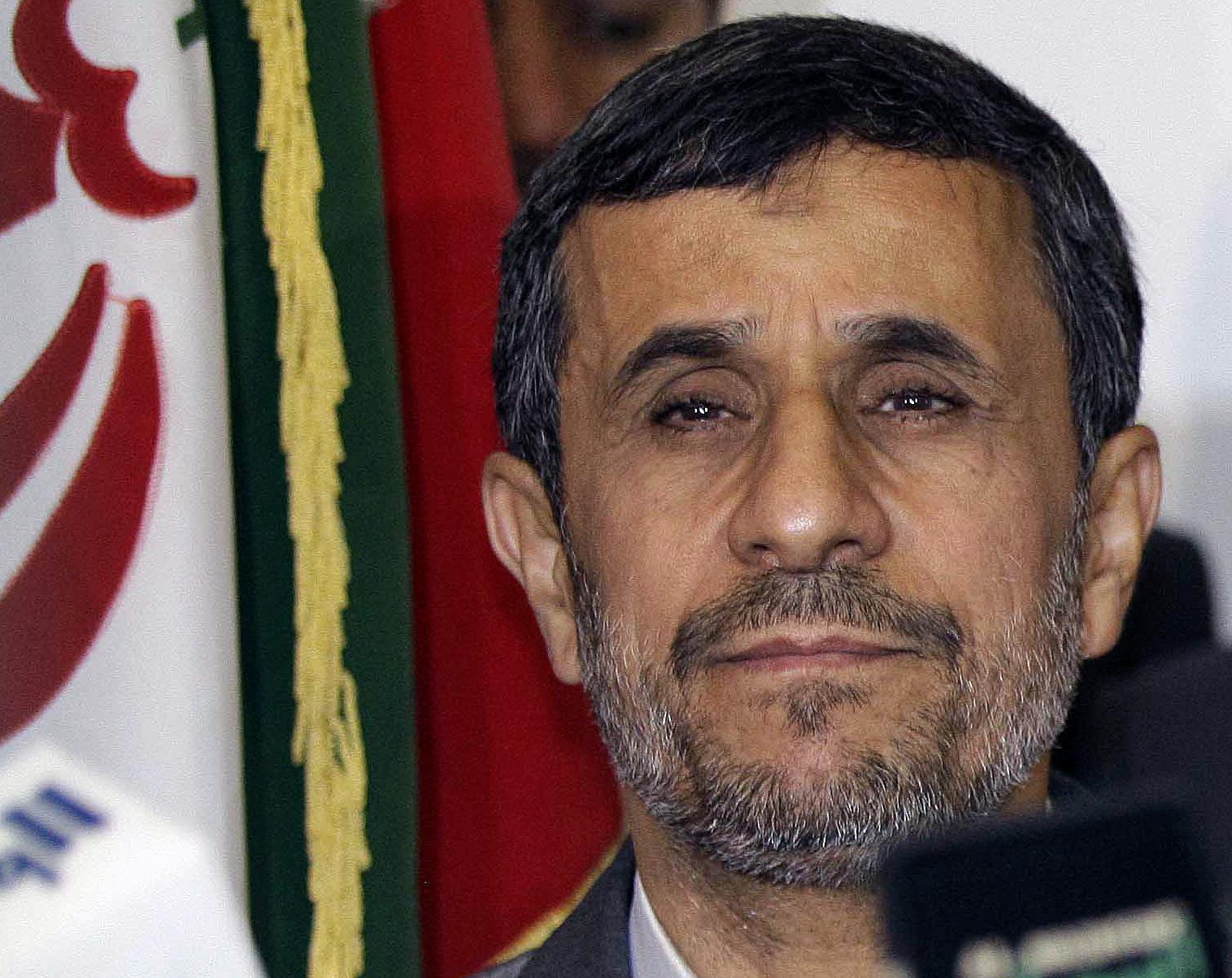 Iran's President Mahmoud Ahmadinejad listens to a question during a joint news conference with Najaf governor Adnan al-Zurufi in Najaf, Iraq, July 19, 2013. REUTERS/Karim Kadim/Pool