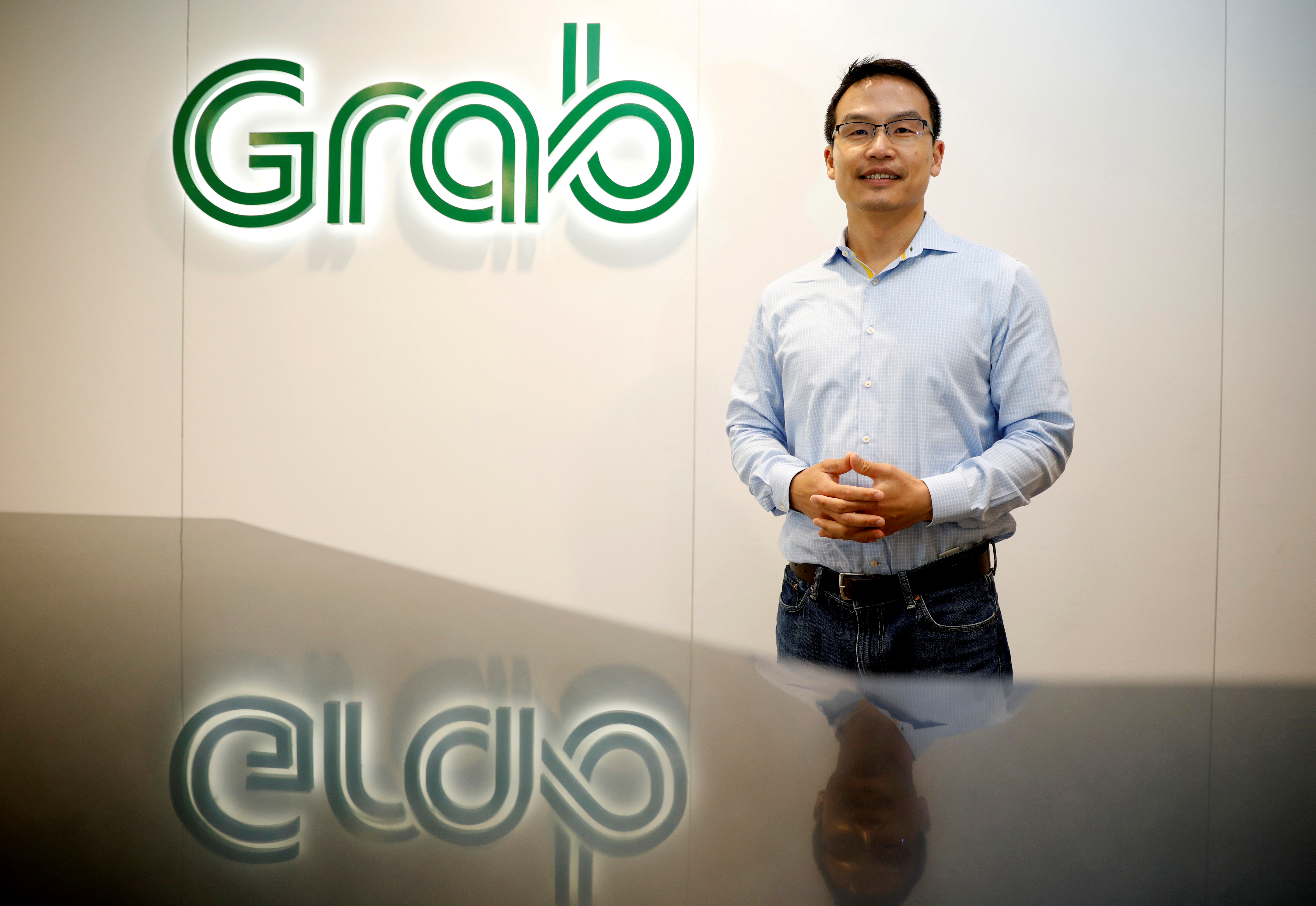 Grab's President Ming Maa poses before an interview with Reuters in Singapore August 22, 2019.  REUTERS/Edgar Su