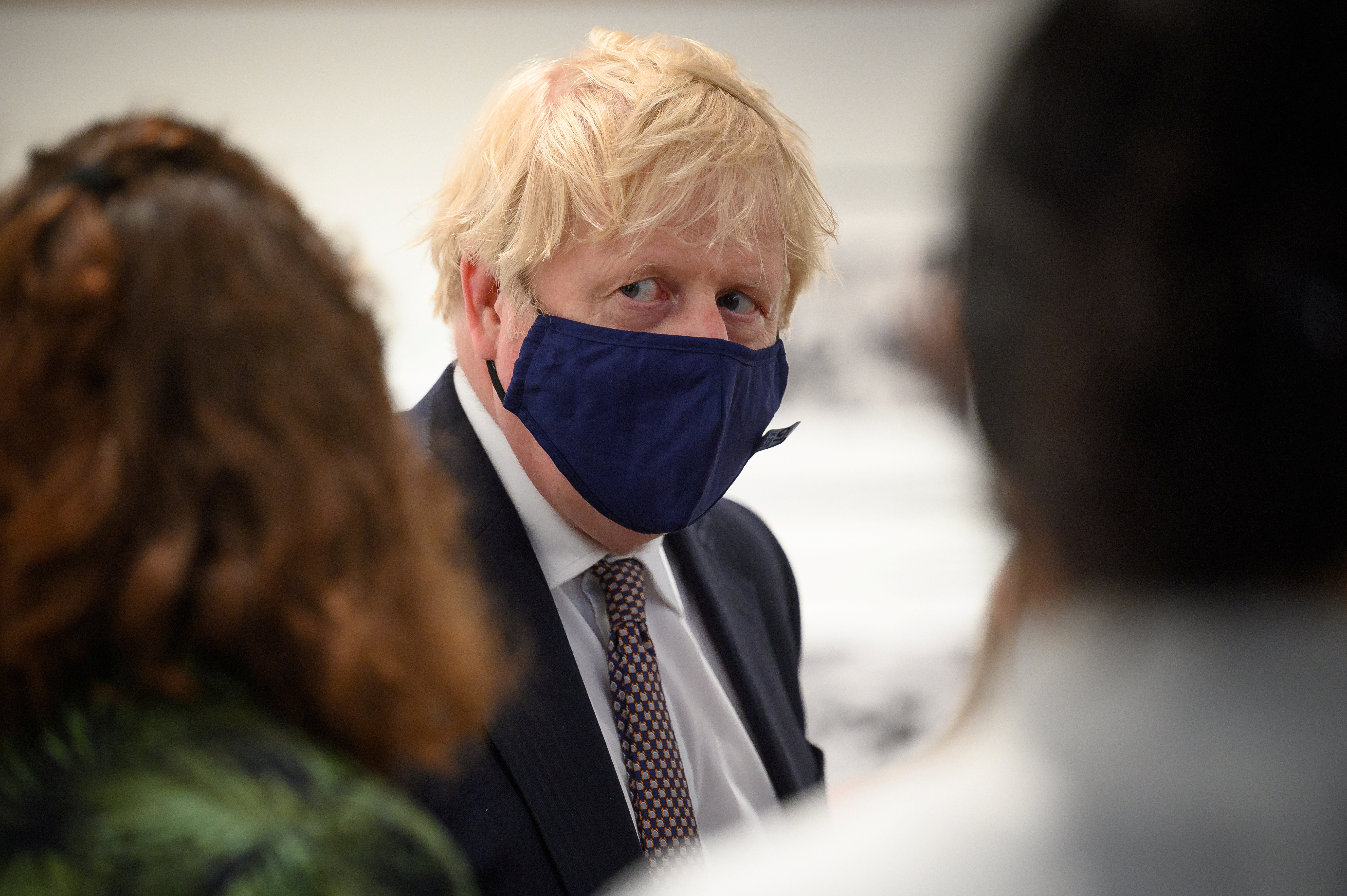 British Prime Minister Boris Johnson discusses the foreign aid cap with a member of an engagement group during a visit to Falmouth's Maritime Museum to meet volunteers and to thank them for hosting the media centre for the G7 Summit, in Falmouth, Britain June 10, 2021. Leon Neal/Pool via REUTERS