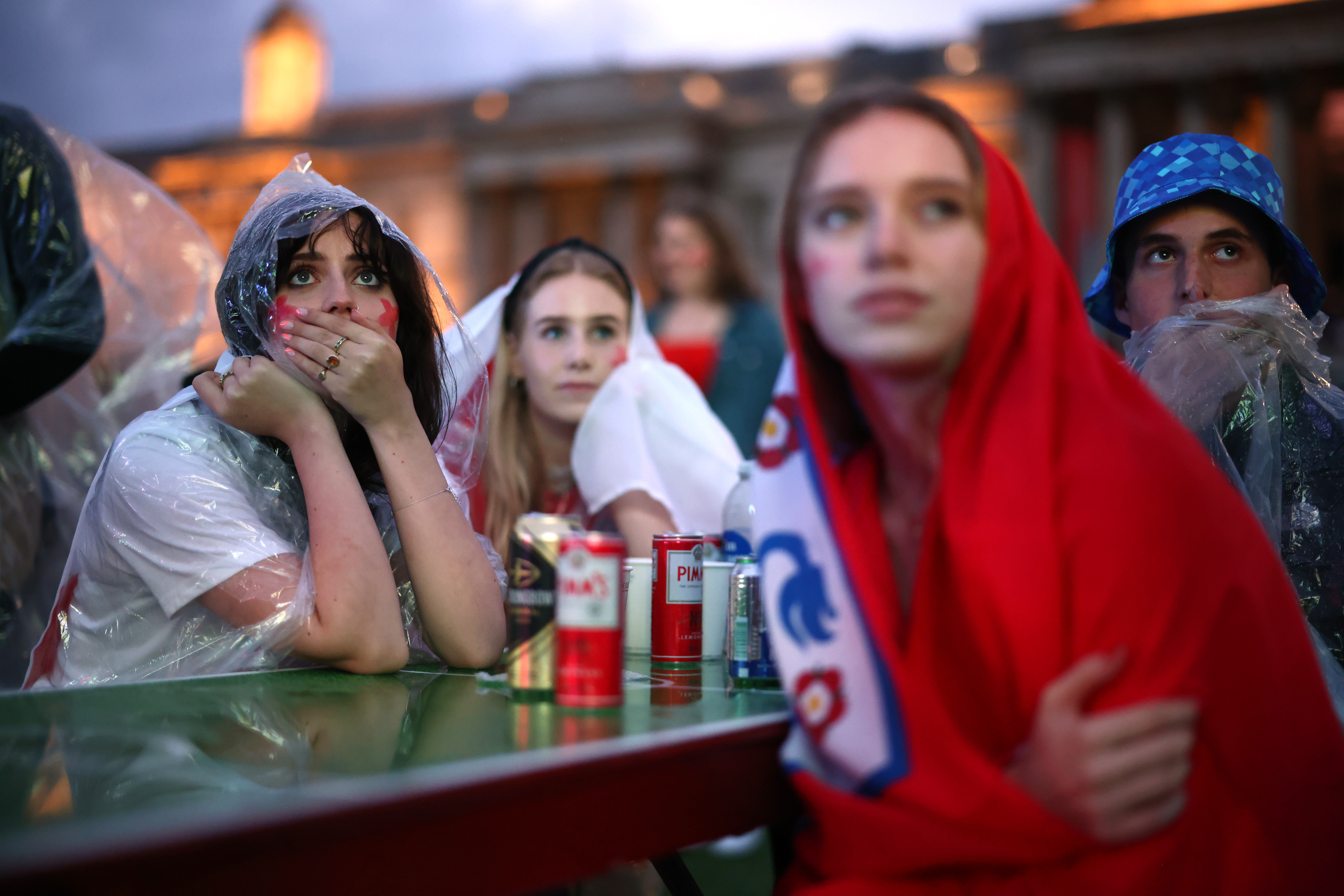 Soccer Football - Euro 2020 - Final - Fans gather for Italy v England - London, Britain - July 11, 2021 England fans react while watching the match at Trafalgar Square REUTERS/Henry Nicholls/File photo