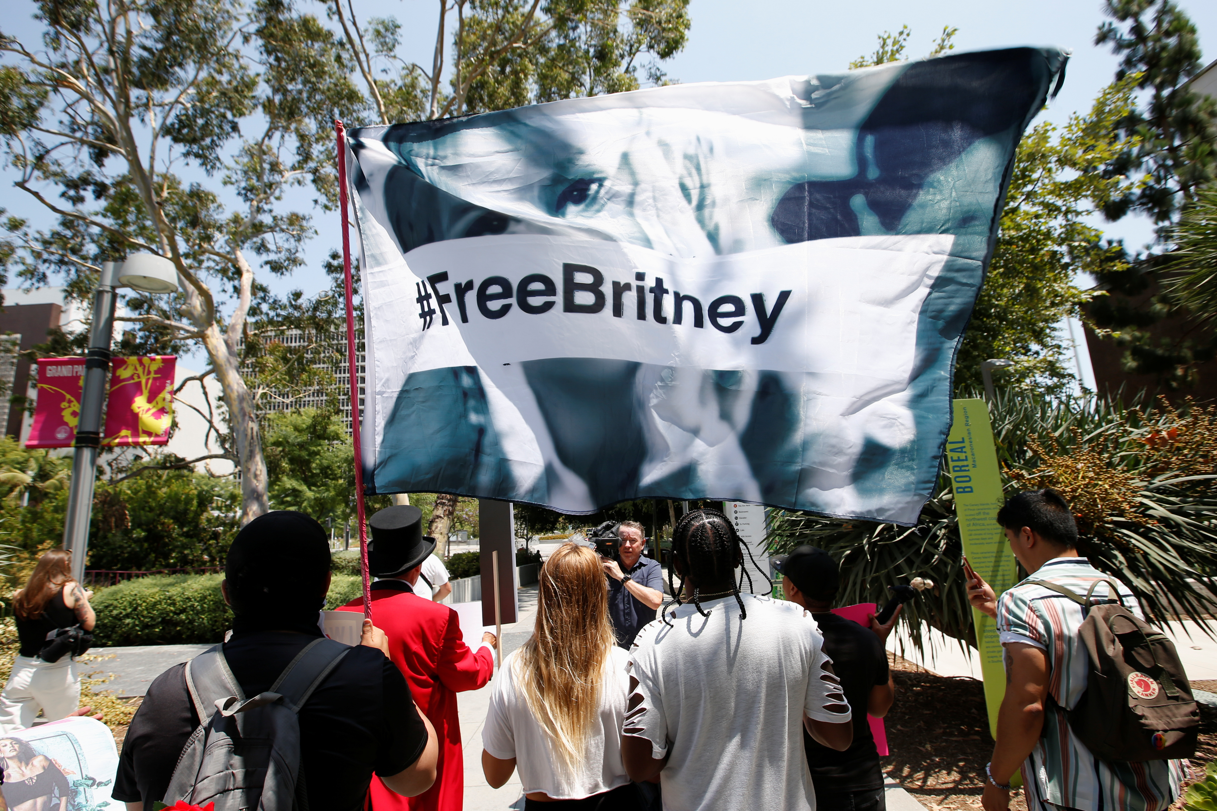 People protest in support of pop star Britney Spears on the day of a conservatorship case hearing at Stanley Mosk Courthouse in Los Angeles, California, U.S., July 14, 2021.  REUTERS/Mario Anzuoni