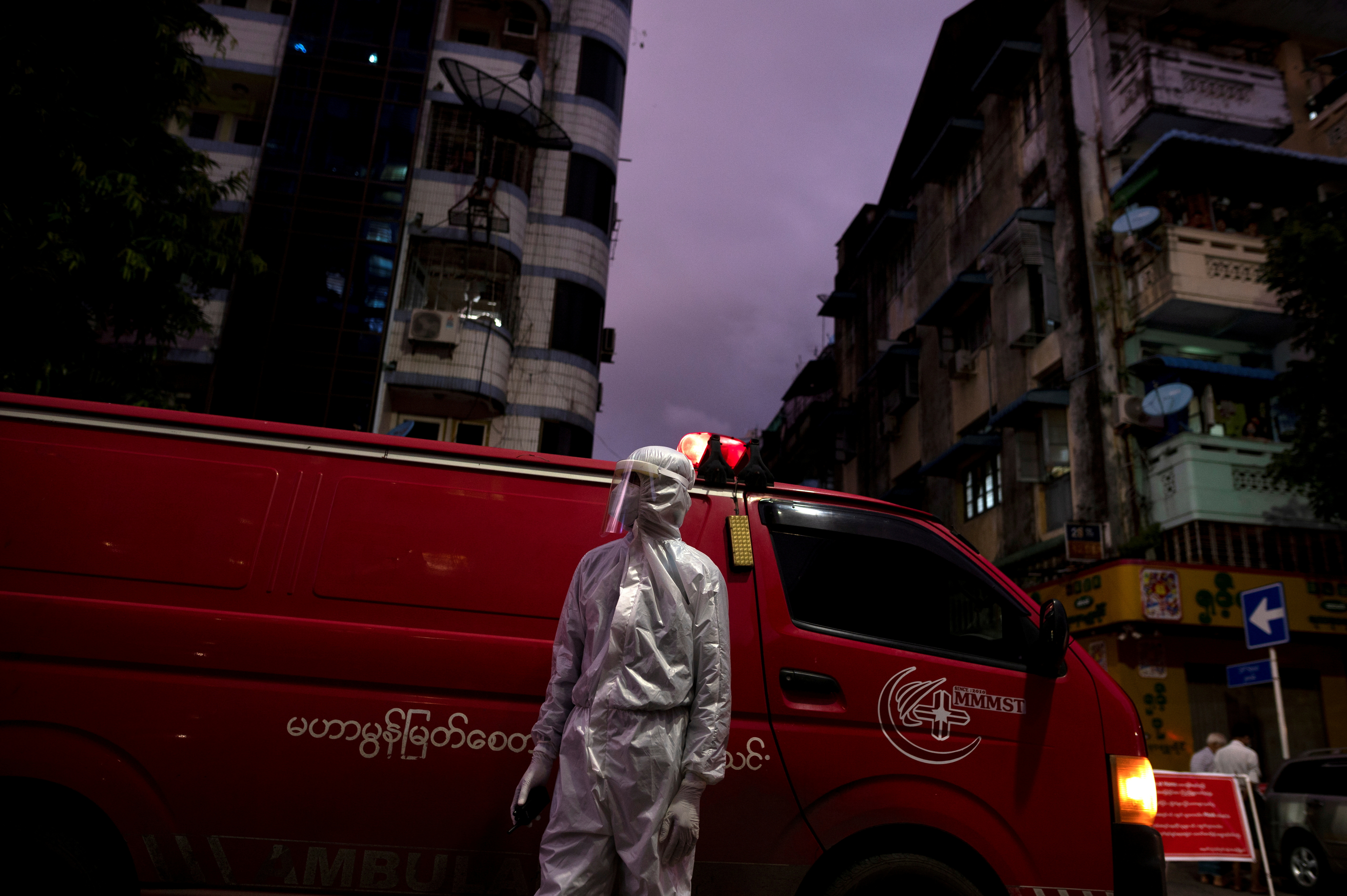 A medical staff wearing a protective suit stands near an ambulance, amid the outbreak of the coronavirus disease (COVID-19), in Yangon, Myanmar, September 27, 2020. REUTERS/Shwe Paw Mya Tin/File Photo/File Photo