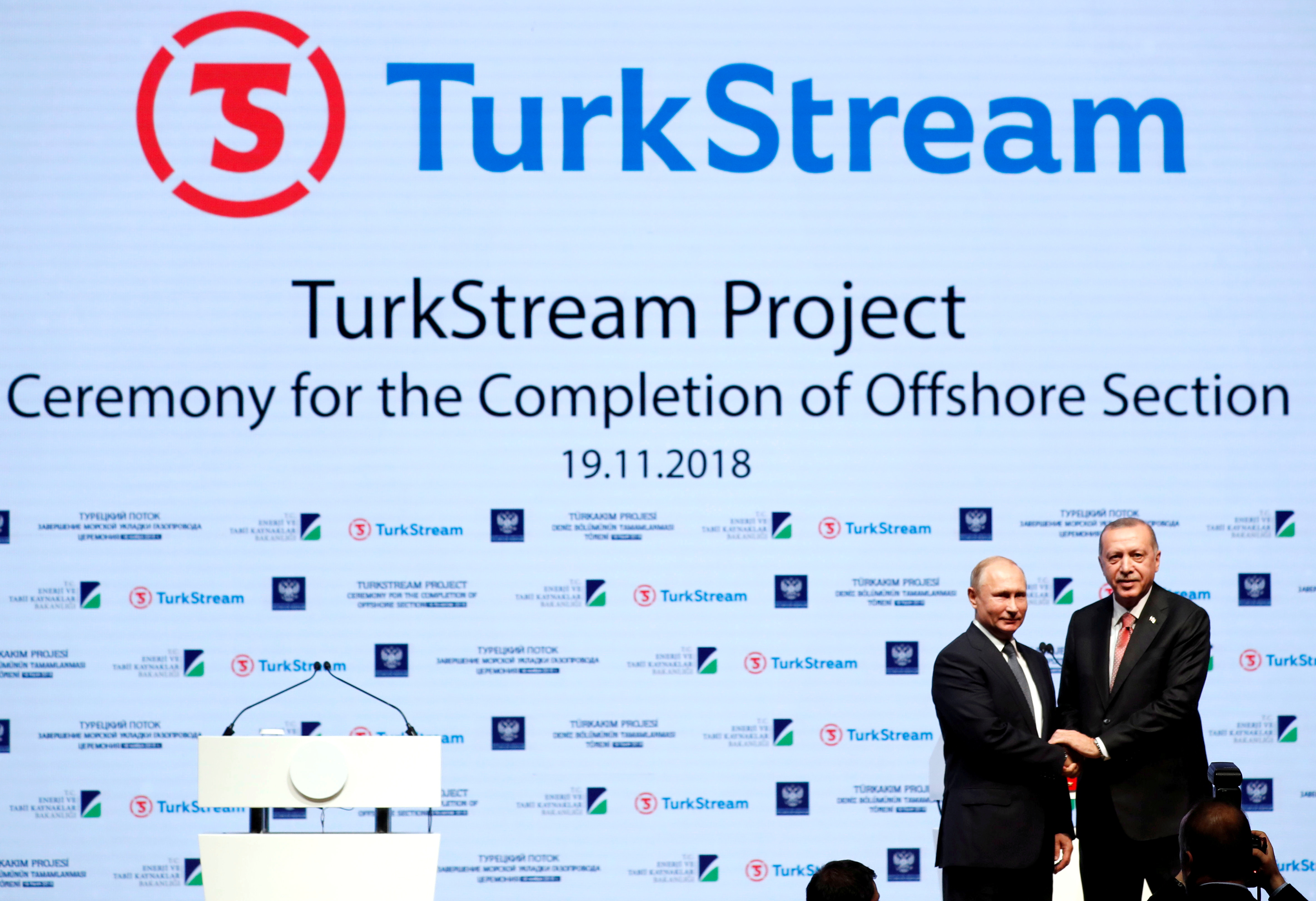 Turkish President Tayyip Erdogan and his Russian counterpart Vladimir Putin shake hands as they attend a ceremony to mark the completion of the sea part of the TurkStream gas pipeline, in Istanbul, Turkey November 19, 2018. REUTERS/Murad Sezer/File Photo