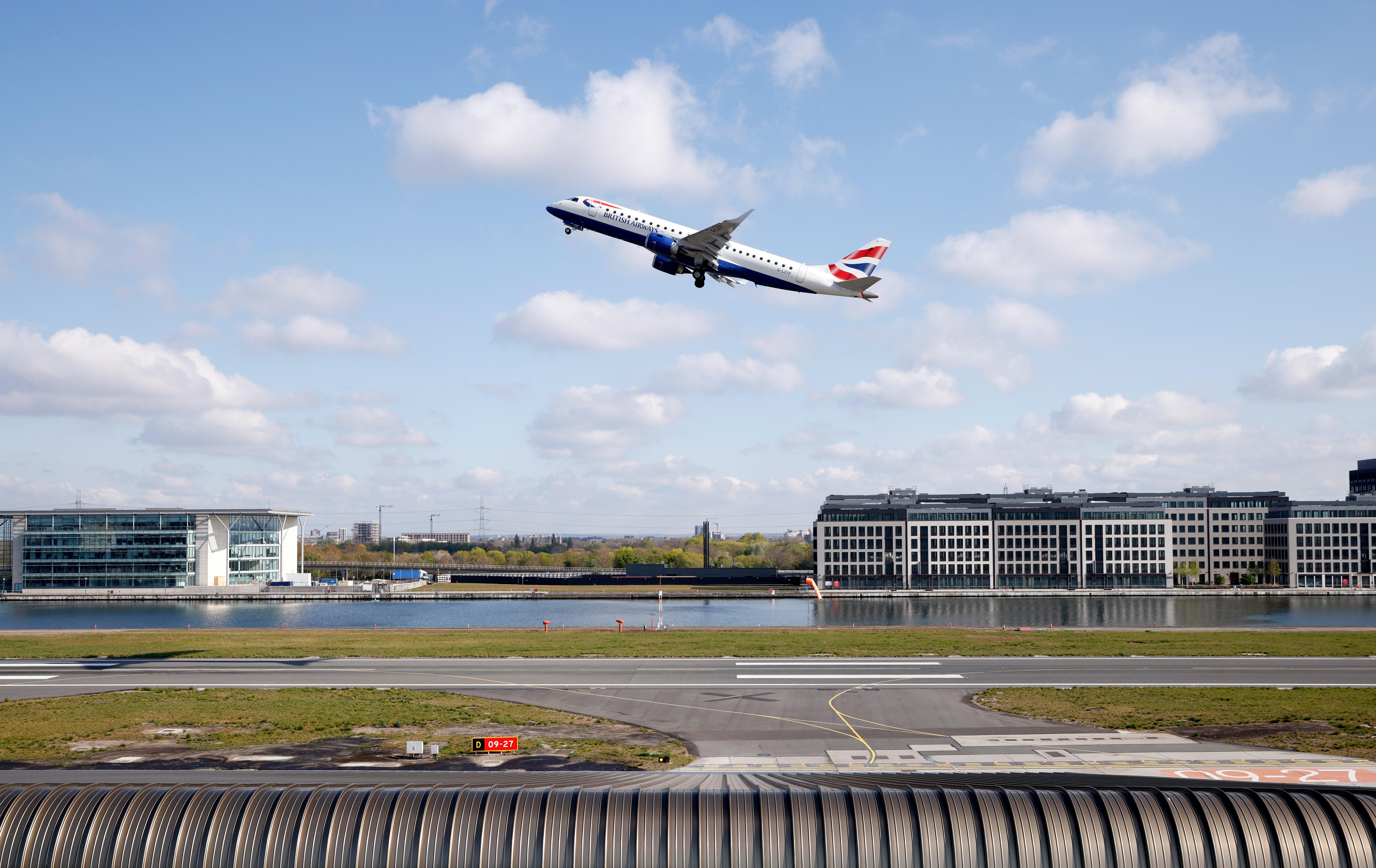 British Airways Embraer 190 aircraft takes off from London City Airport, Britain, April 29, 2021. REUTERS/John Sibley