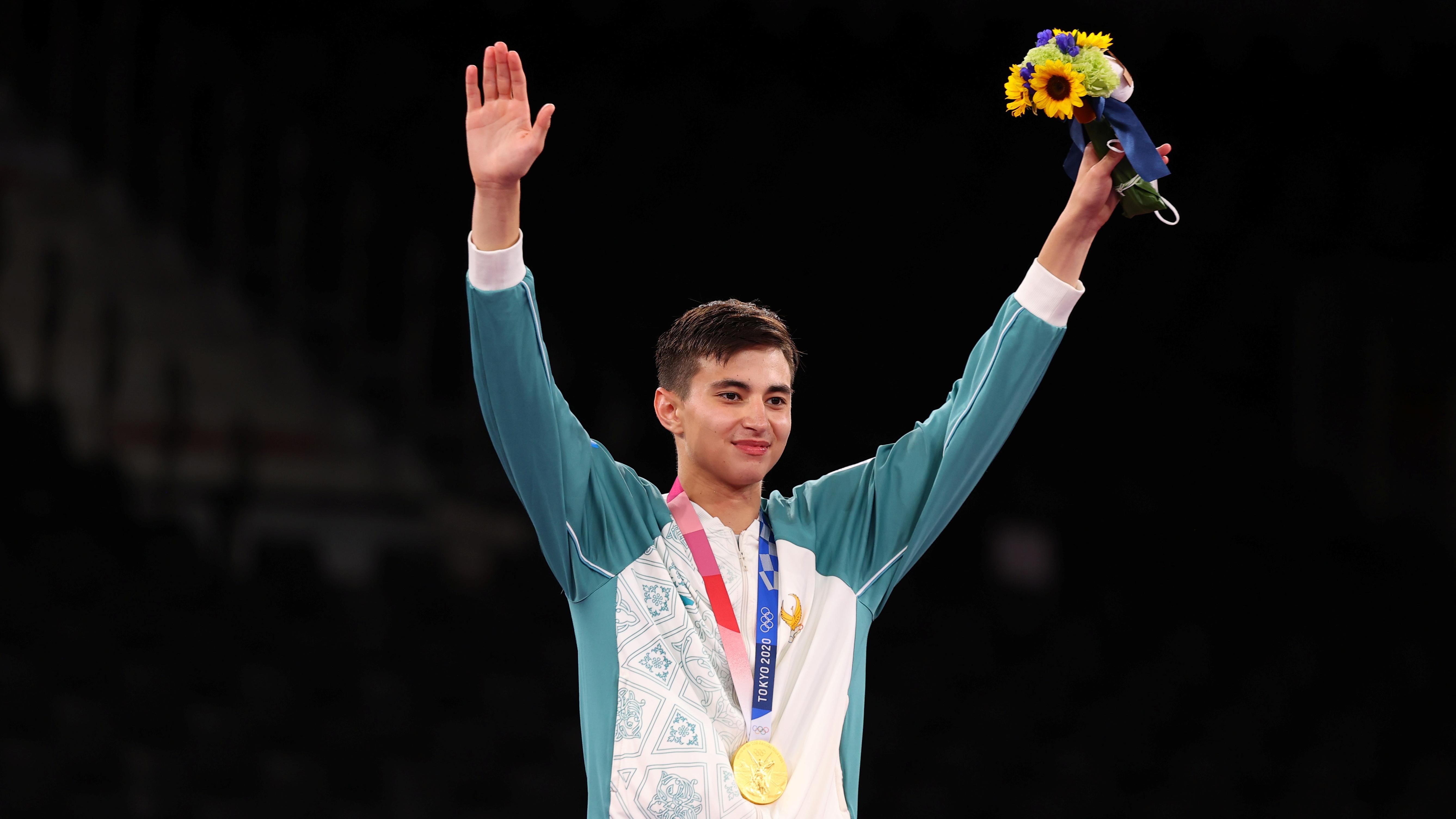 Tokyo 2020 Olympics - Taekwondo - Men's Featherweight 58-68kg - Medal Ceremony - Makuhari Messe Hall A, Chiba, Japan - July 25, 2021. Ulugbek Rashitov of Uzbekistan celebrates after winning gold REUTERS/Murad Sezer