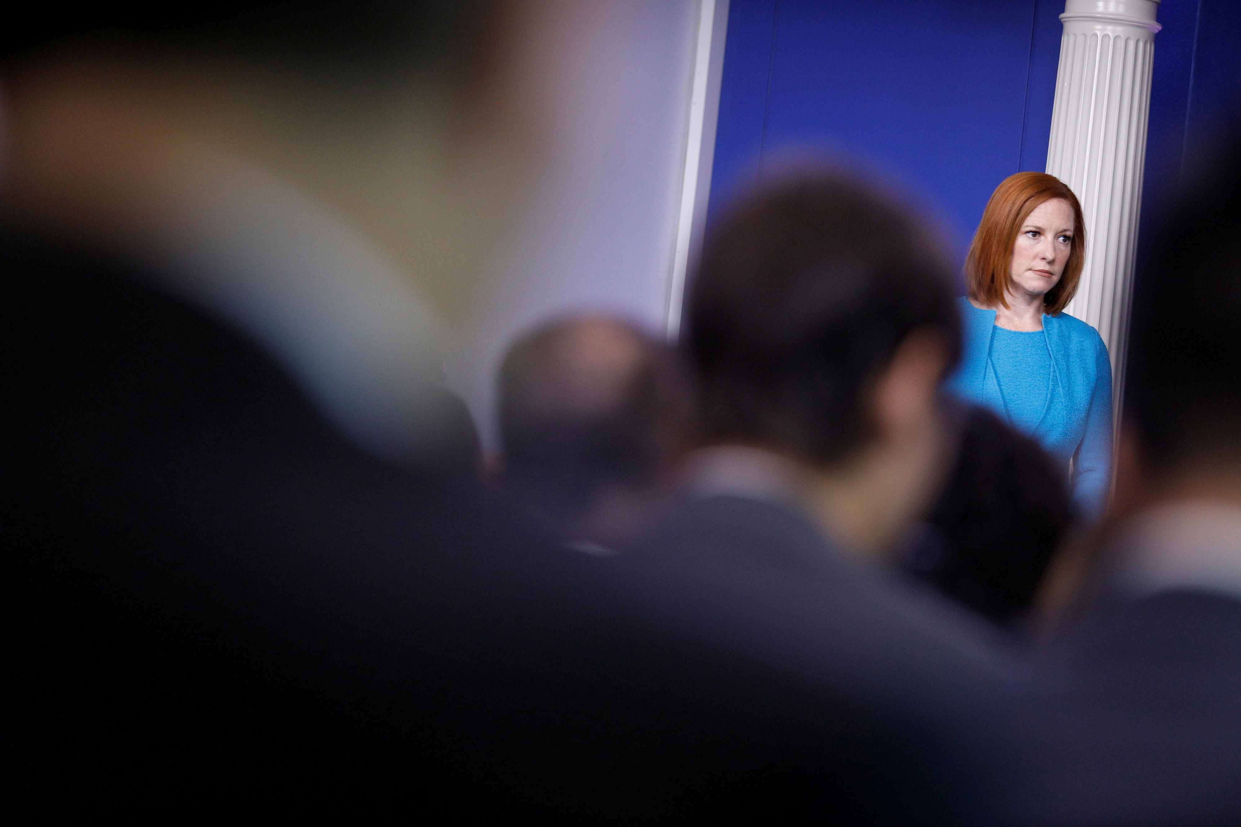 White House Press Secretary Jen Psaki looks on as United States Surgeon General Vivek Murthy delivers remarks during a news conference at the White House in Washington, U.S., July15, 2021. REUTERS/Tom Brenner
