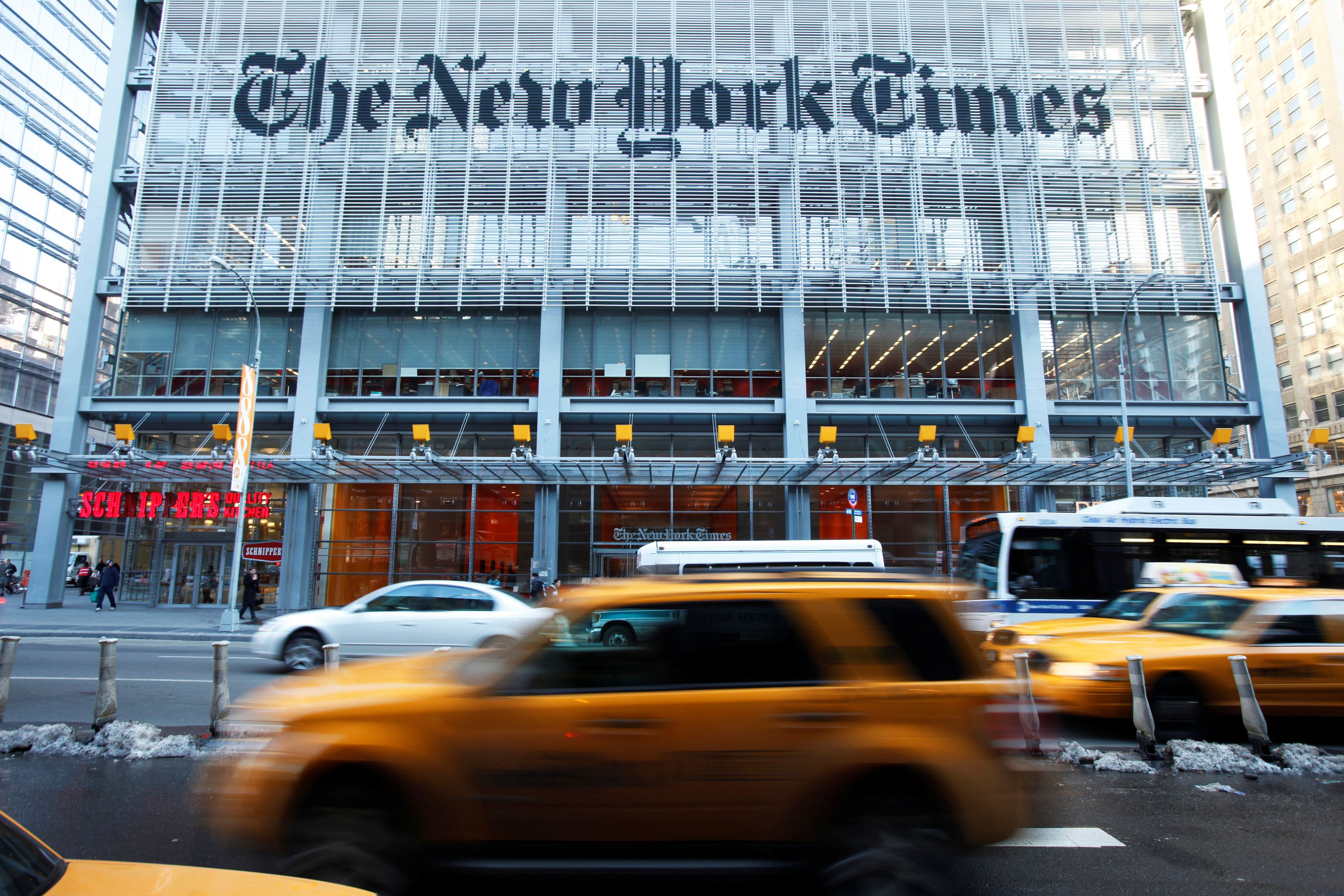 Vehicles drive past the New York Times headquarters in New York March 1, 2010. REUTERS/Lucas Jackson/File Photo