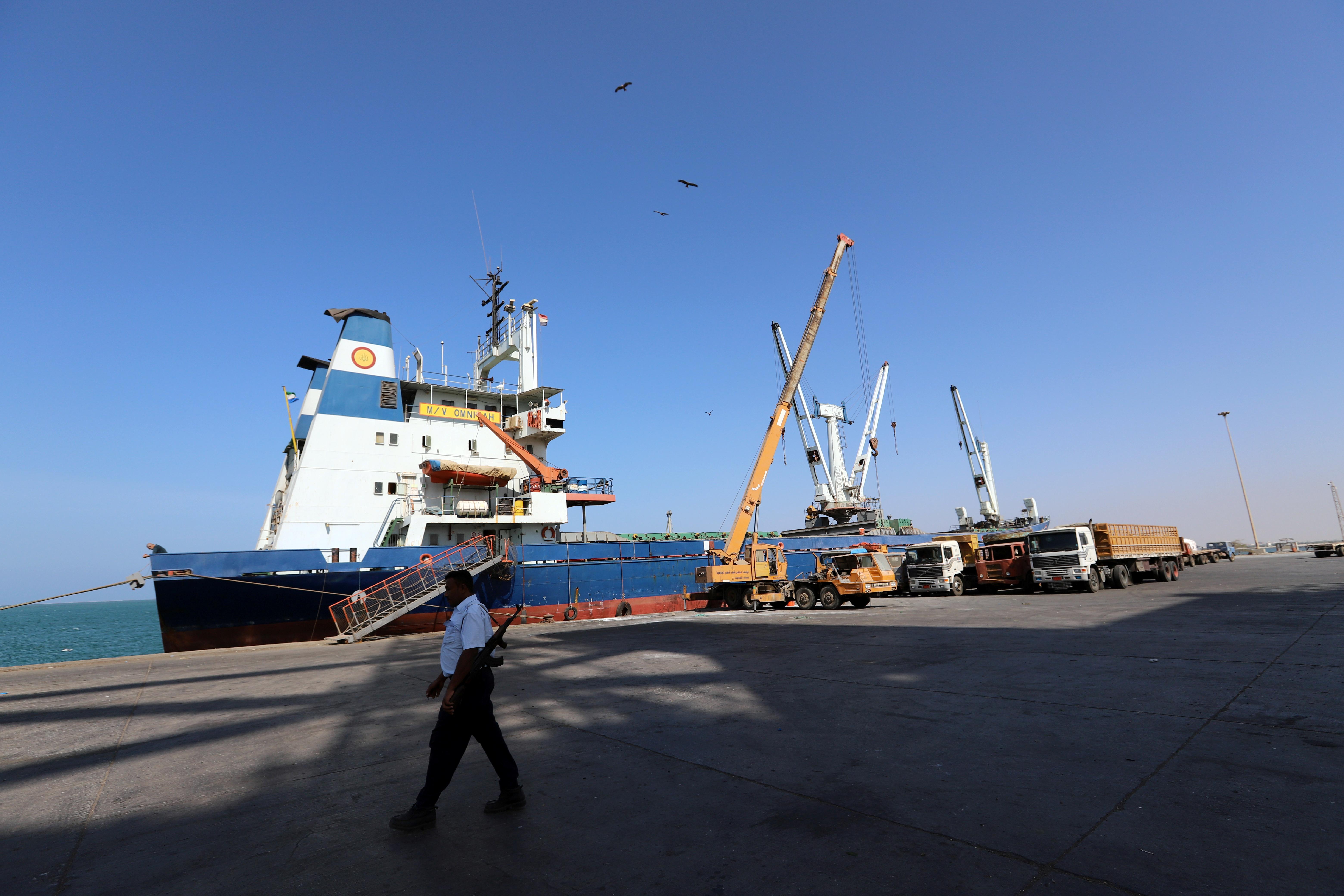 A coast guard walks past a ship docked at the Red Sea port of Hodeidah, Yemen January 5, 2019. Picture taken January 5, 2019. REUTERS/Abduljabbar Zeyad
