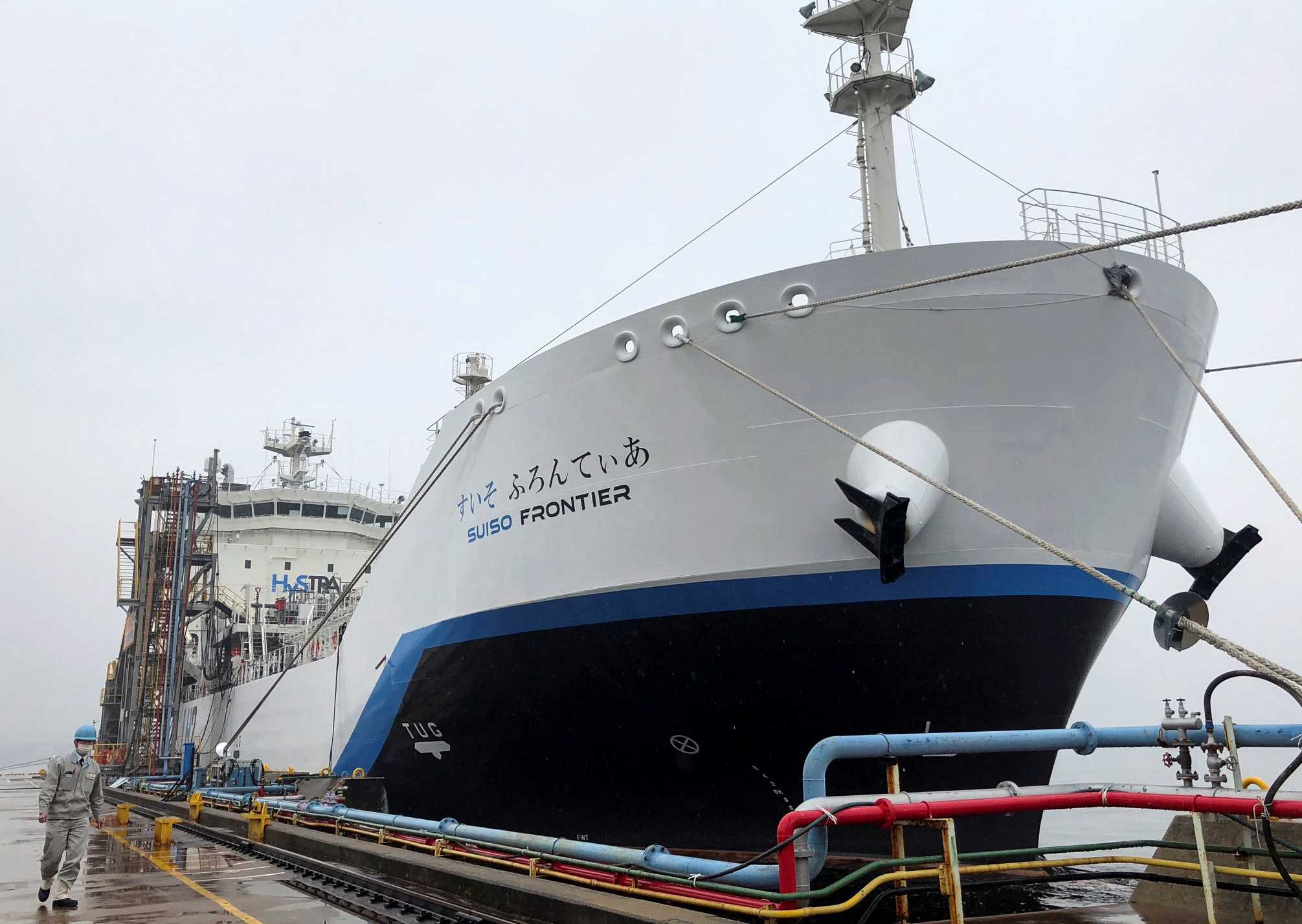 The liquefied hydrogen carrier SUISO FRONTIER, built by Kawasaki Heavy Industries and is due to transport its first cargo of hydrogen extracted from brown coal from Australia to Japan, is docked at Kobe Works yard in Kobe, western Japan January 22, 2021. REUTERS/Yuka Obayashi