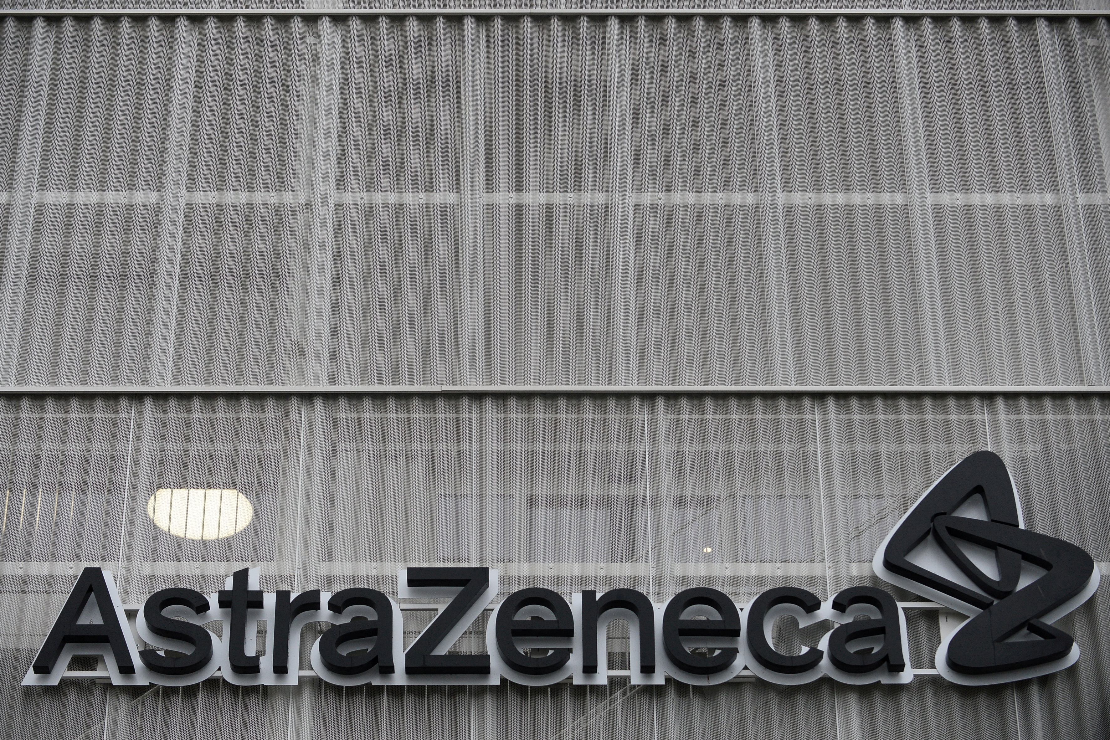 The AstraZeneca logo is pictured outside the AstraZeneca office building in Brussels as part of the coronavirus disease (COVID-19) vaccination campaign, Belgium, January 28, 2021. REUTERS/Johanna Geron