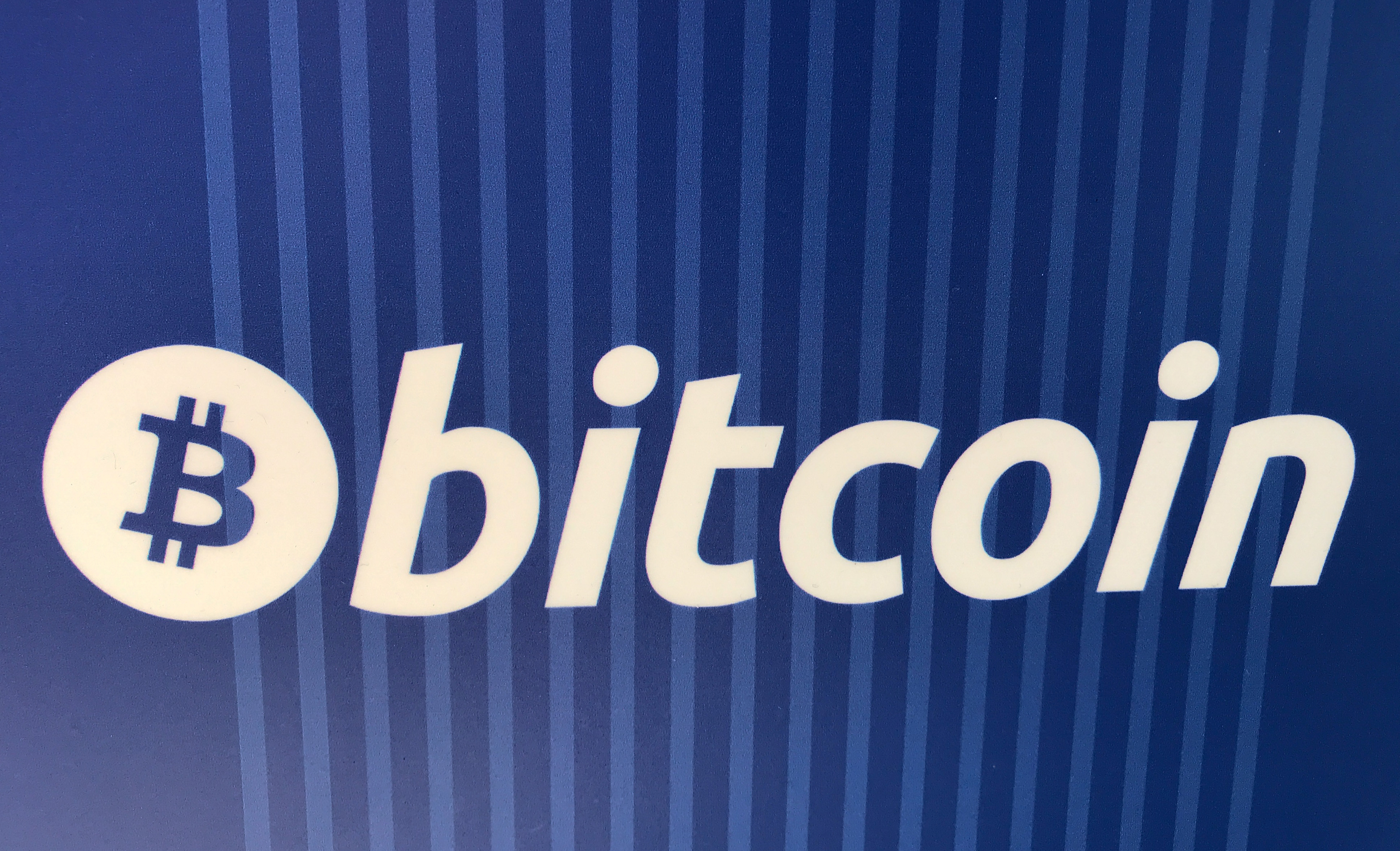A Bitcoin logo is seen on a cryptocurrency ATM in Santa Monica, California, U.S., January 4, 2018. REUTERS/Lucy Nicholson.