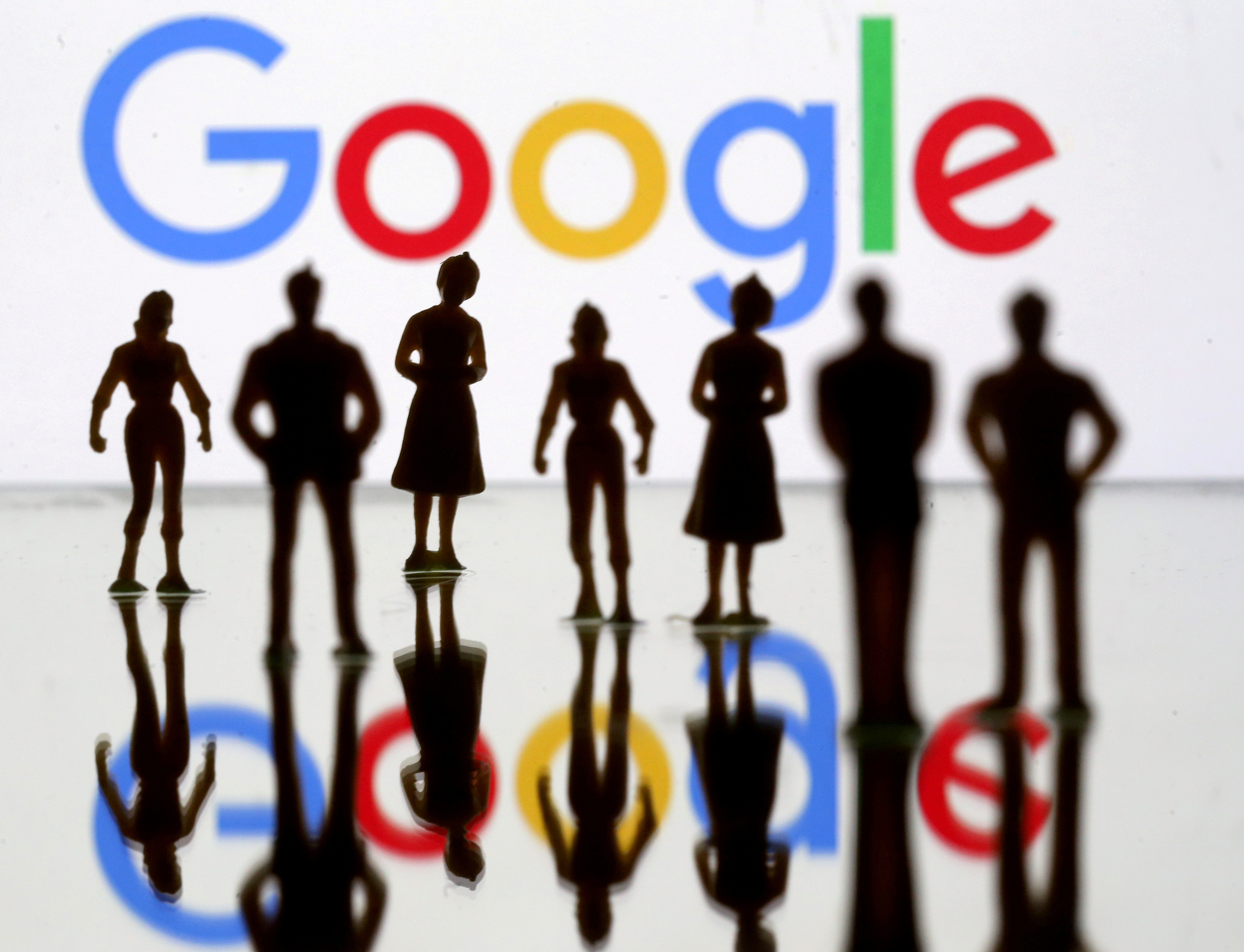 Small toy figures are seen in front of Google logo in this illustration picture, April 8, 2019. REUTERS/Dado Ruvic/File Photo