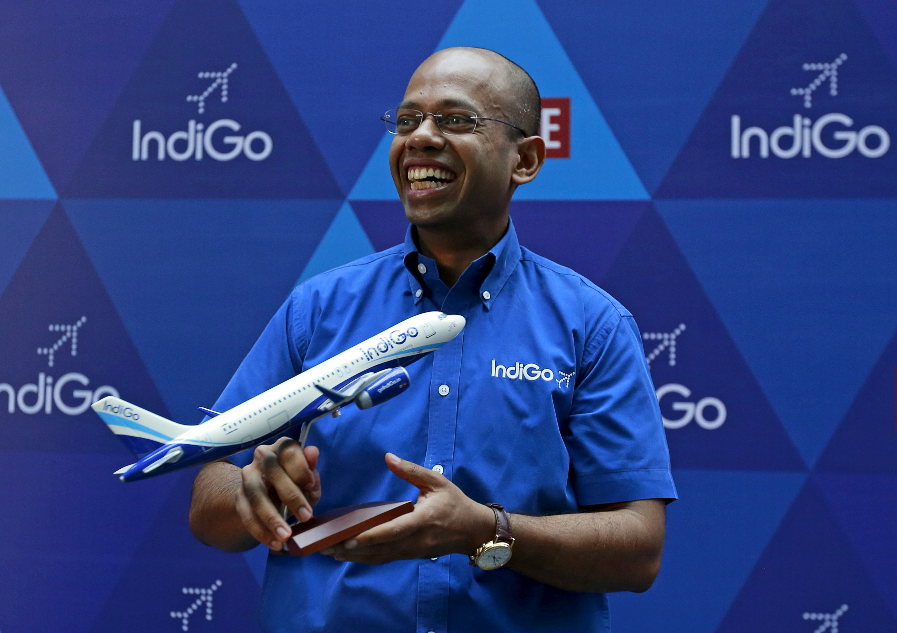 President of InterGlobe Aviation Limited Aditya Ghosh holds a memento during the company's listing ceremony at the National Stock Exchange (NSE) in Mumbai, India, November 10, 2015. REUTERS/Danish Siddiqui/File Photo