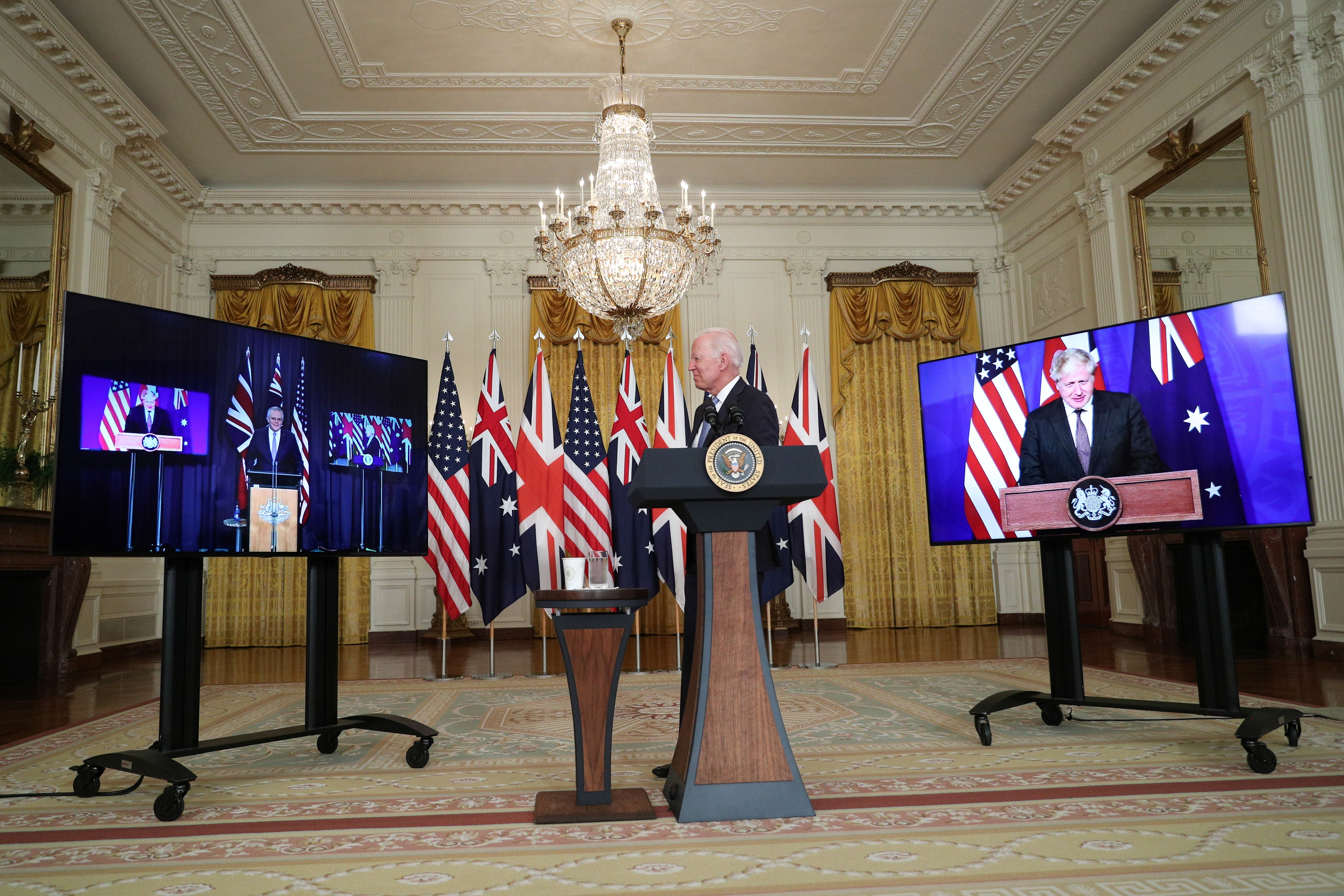 U.S. President Joe Biden delivers remarks on a National Security Initiative virtually with Australian Prime Minister Scott Morrison and British Prime Minister Boris Johnson, inside the East Room at the White House in Washington, U.S., September 15, 2021.  REUTERS/Tom Brenner