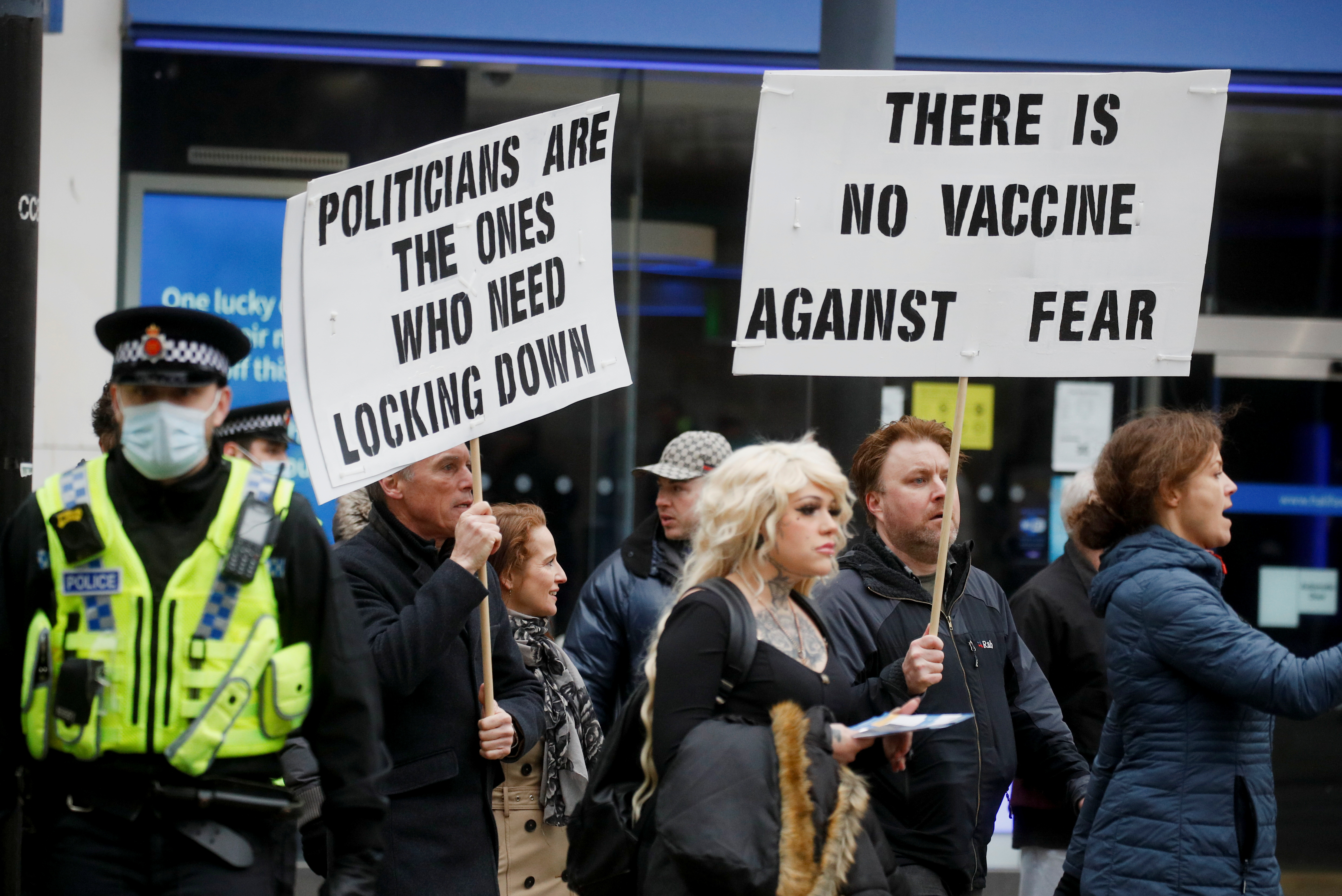 People participate in a protest against the lockdown, amid the spread of the coronavirus disease (COVID-19), in Manchester, Britain March 20, 2021. REUTERS/Phil Noble