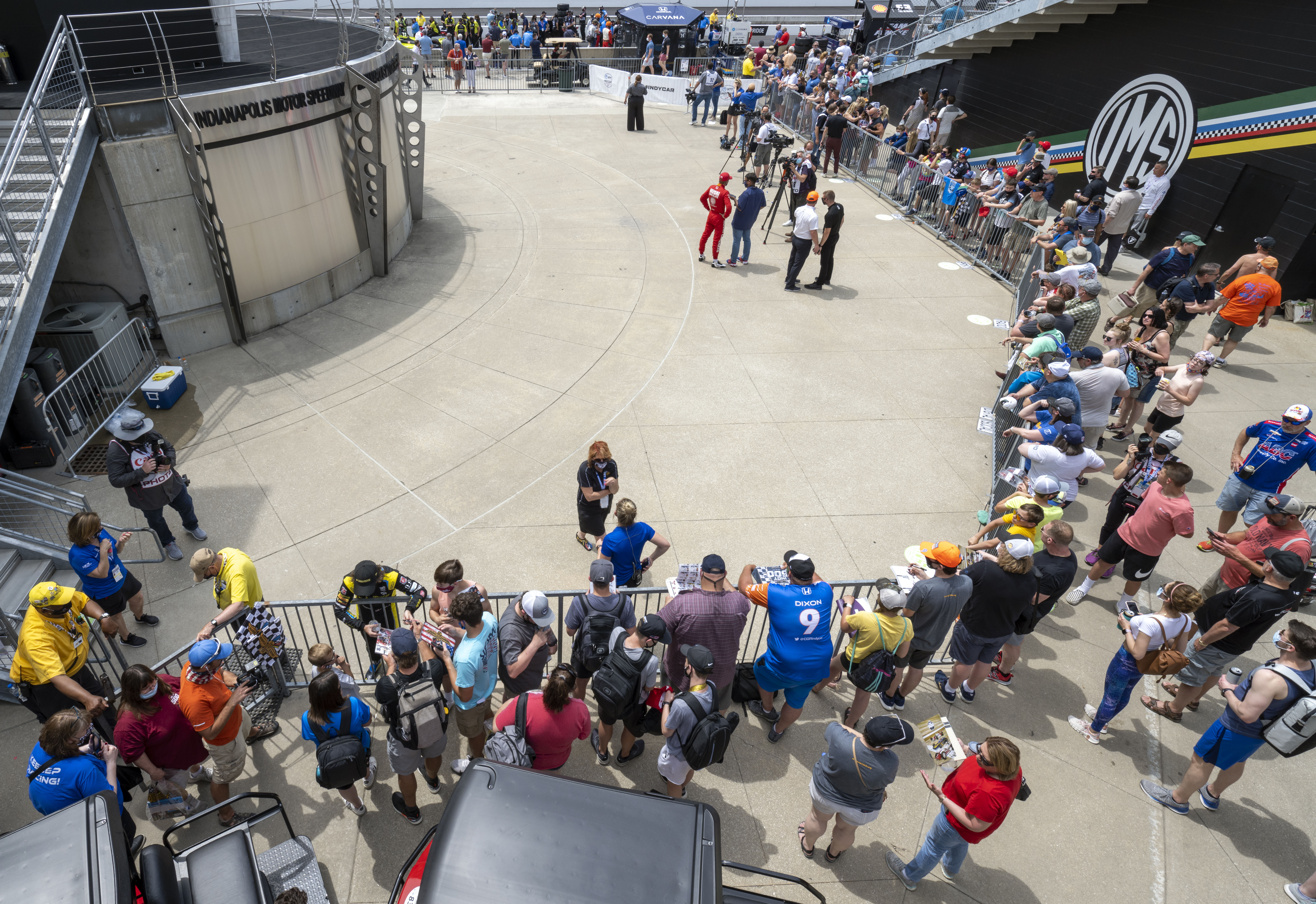 May 22, 2021; Indianapolis, IN, USA; A crowd forms waiting for an opportunity to see drivers give media interviews during the first day of qualifying for the 2021 Indianapolis 500 at the Indianapolis Motor Speedway. / Marc Lebryk-USA TODAY Sports/File Photo