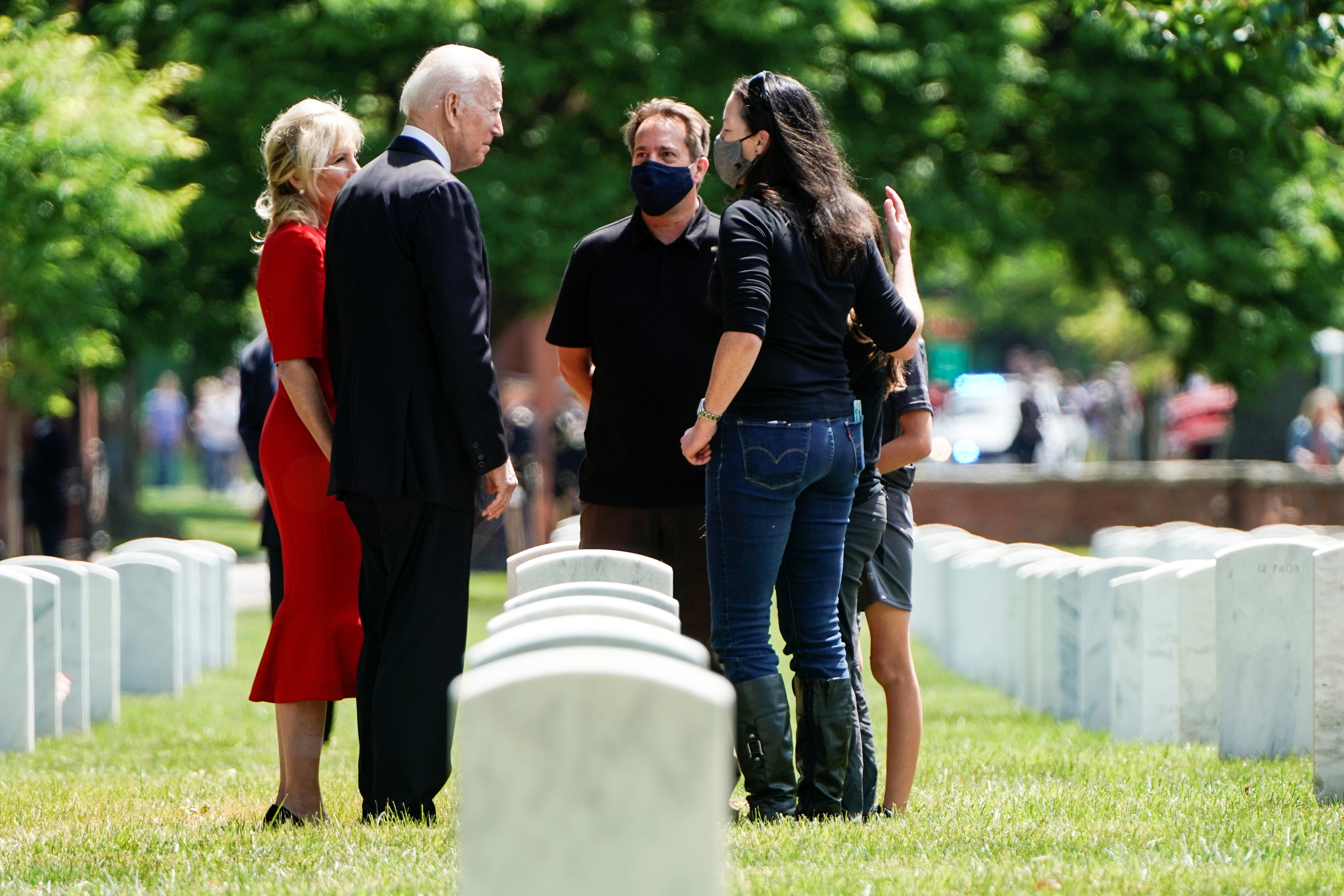U.S. President Joe Biden and U.S. first lady Dr. Jill Biden greet one of the families on Memorial Day in Section 12 of Arlington National Cemetery in Virginia, U.S., May 31, 2021.      REUTERS/Joshua Roberts