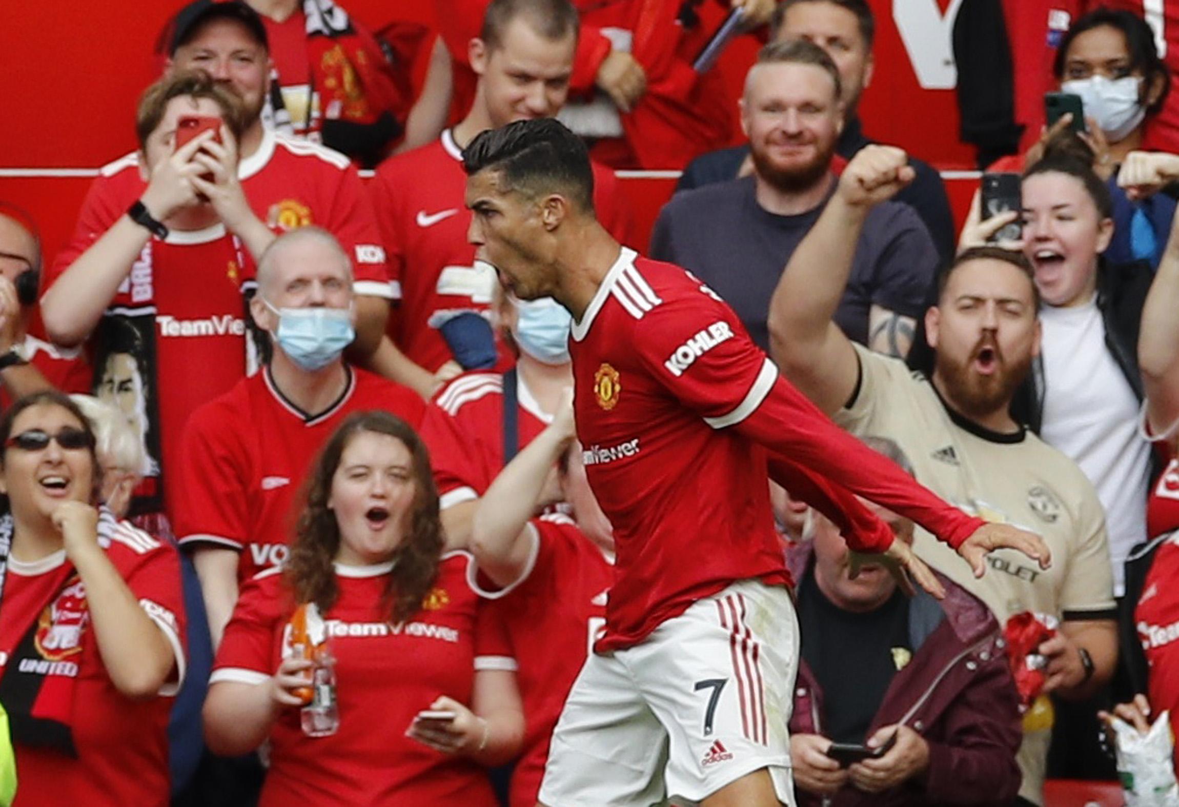 Ronaldo debut double as Man Utd thrash Newcastle to go top | Reuters