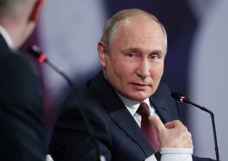 Putin says Russia would accept conditional handover of cyber criminals to  U.S. | Reuters