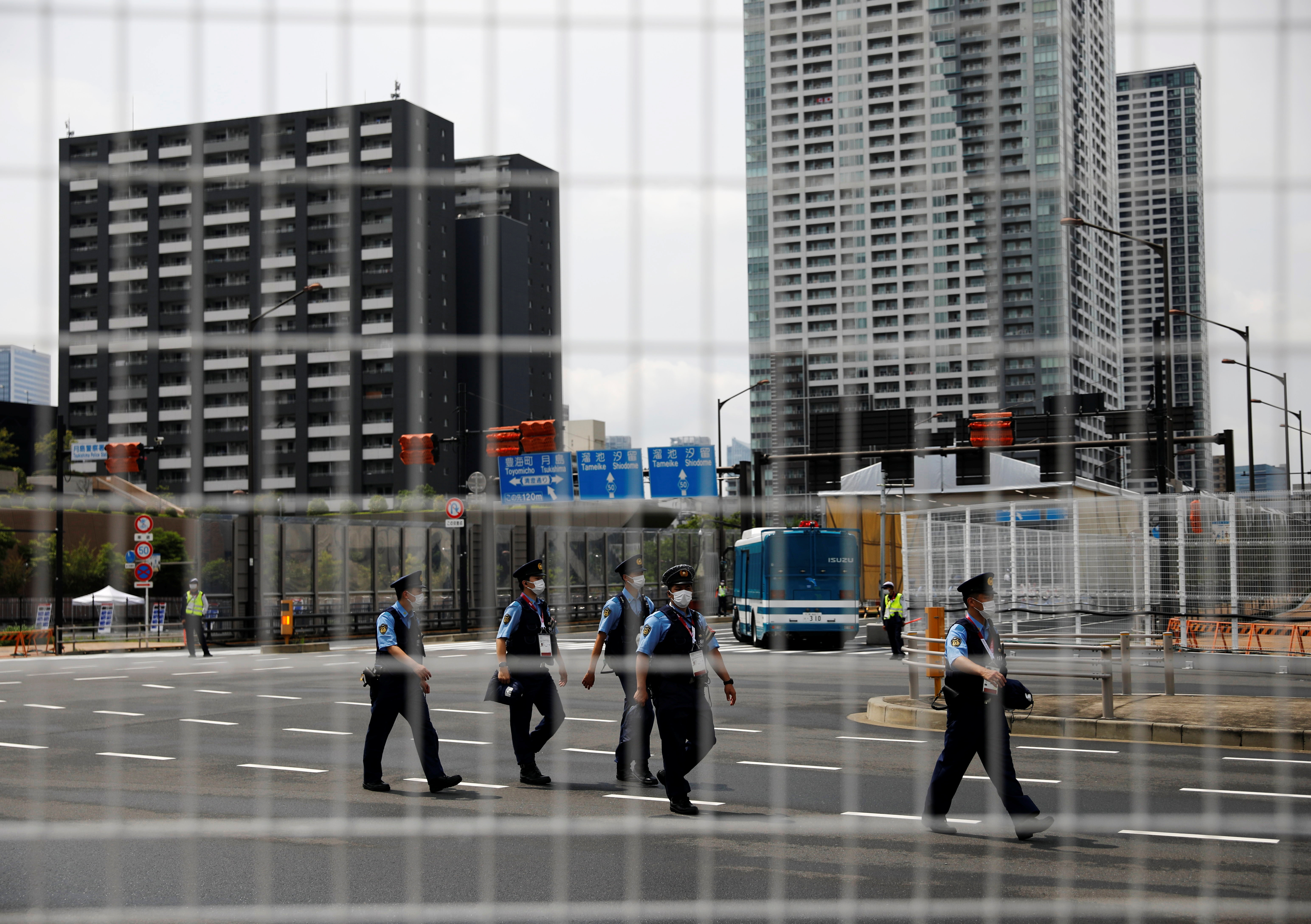 Police officers patrol at the Athletes Village ahead of the Tokyo 2020 Olympic Games that have been postponed to 2021 due to the coronavirus disease (COVID-19) pandemic, in Tokyo, Japan July 13, 2021.  REUTERS/Issei Kato