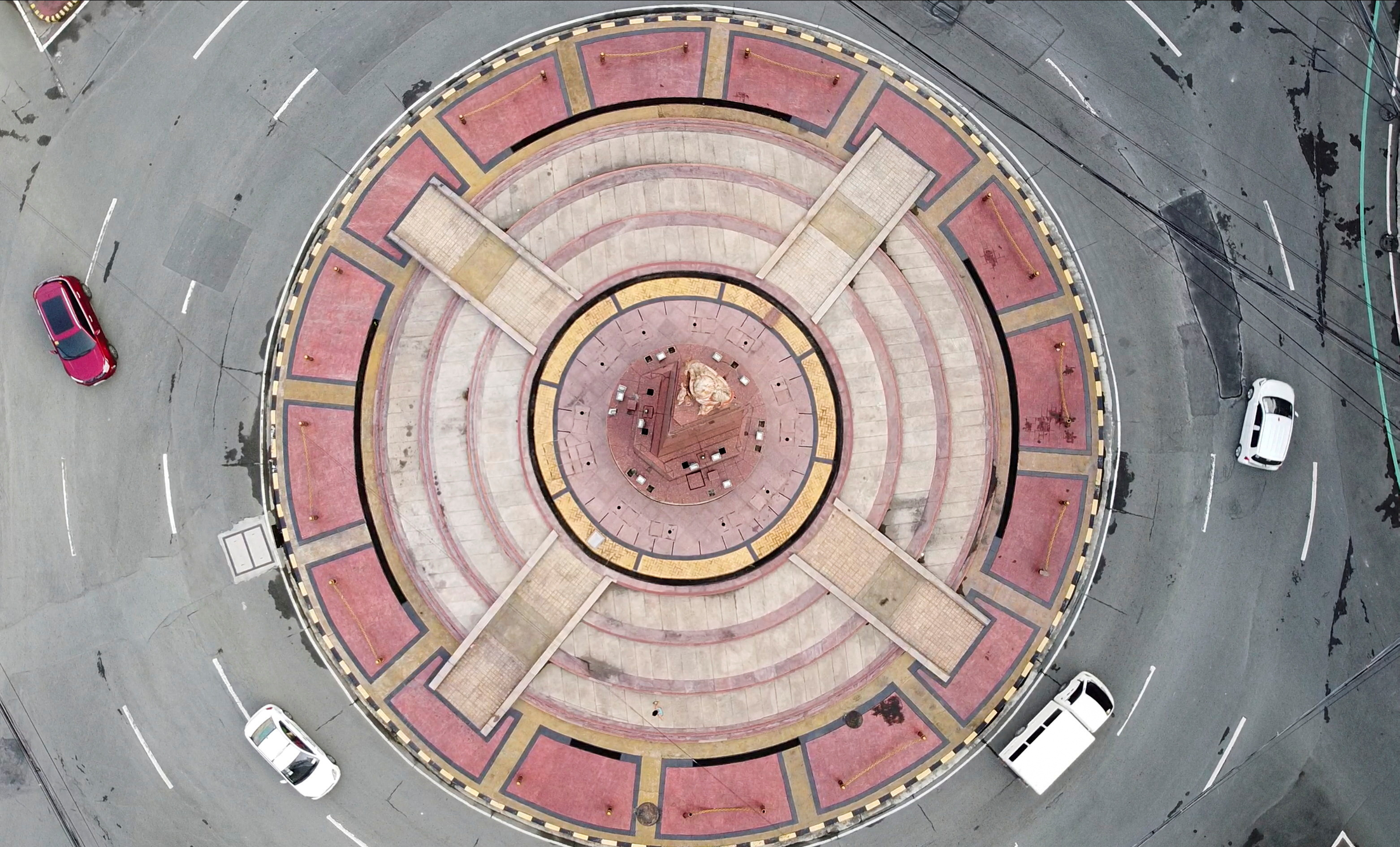An aerial view shows minimal traffic in a roundabout in Quezon City, during a two-week lockdown following a surge in coronavirus disease (COVID-19) cases, in Metro Manila, Philippines August 9, 2021. Picture taken with a drone. REUTERS/Adrian Portugal/Files