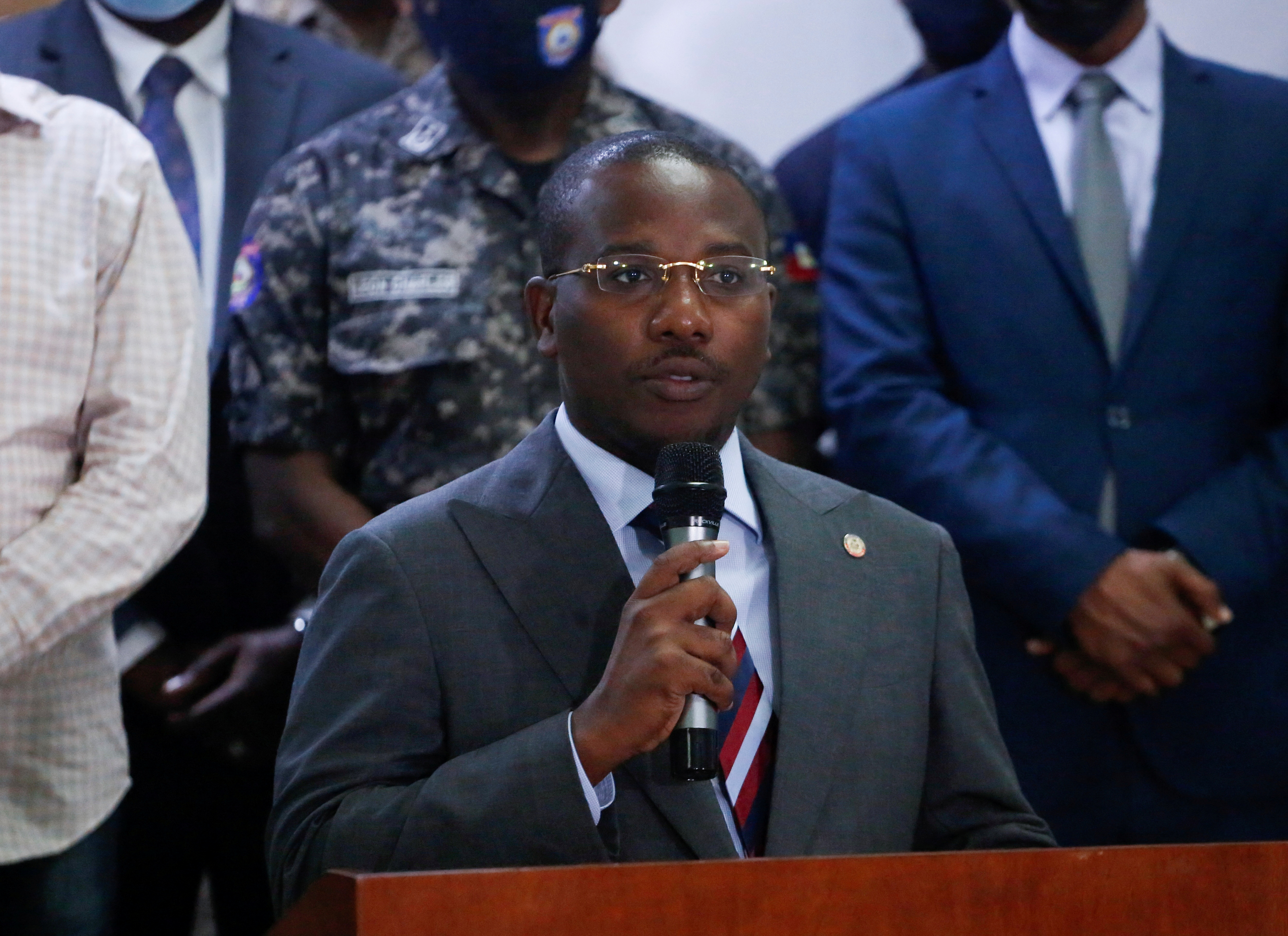 Haiti's interim Prime Minister Claude Joseph addresses the audience after suspects in the assassination of President Jovenel Moise, who was shot dead early Wednesday at his home, were shown to the media, in Port-au-Prince, Haiti July 8, 2021. REUTERS/Estailove St-Val/File Photo