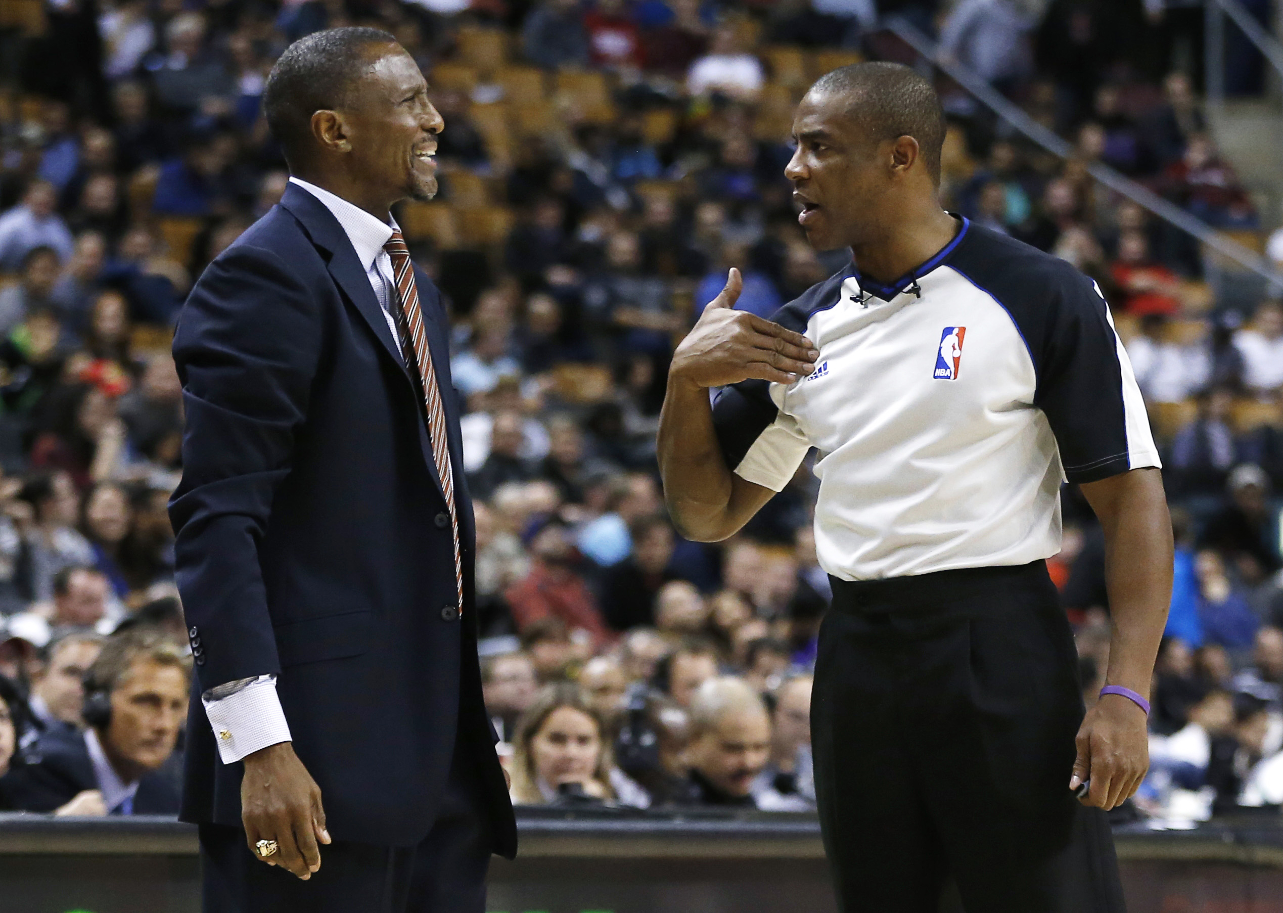 Toronto Raptors' head coach Dwane Casey complains to referee Tony Brown during a break in play against the Utah Jazz during the overtime of their NBA basketball game in Toronto November 12, 2012.     REUTERS/Mark Blinch /File Photo