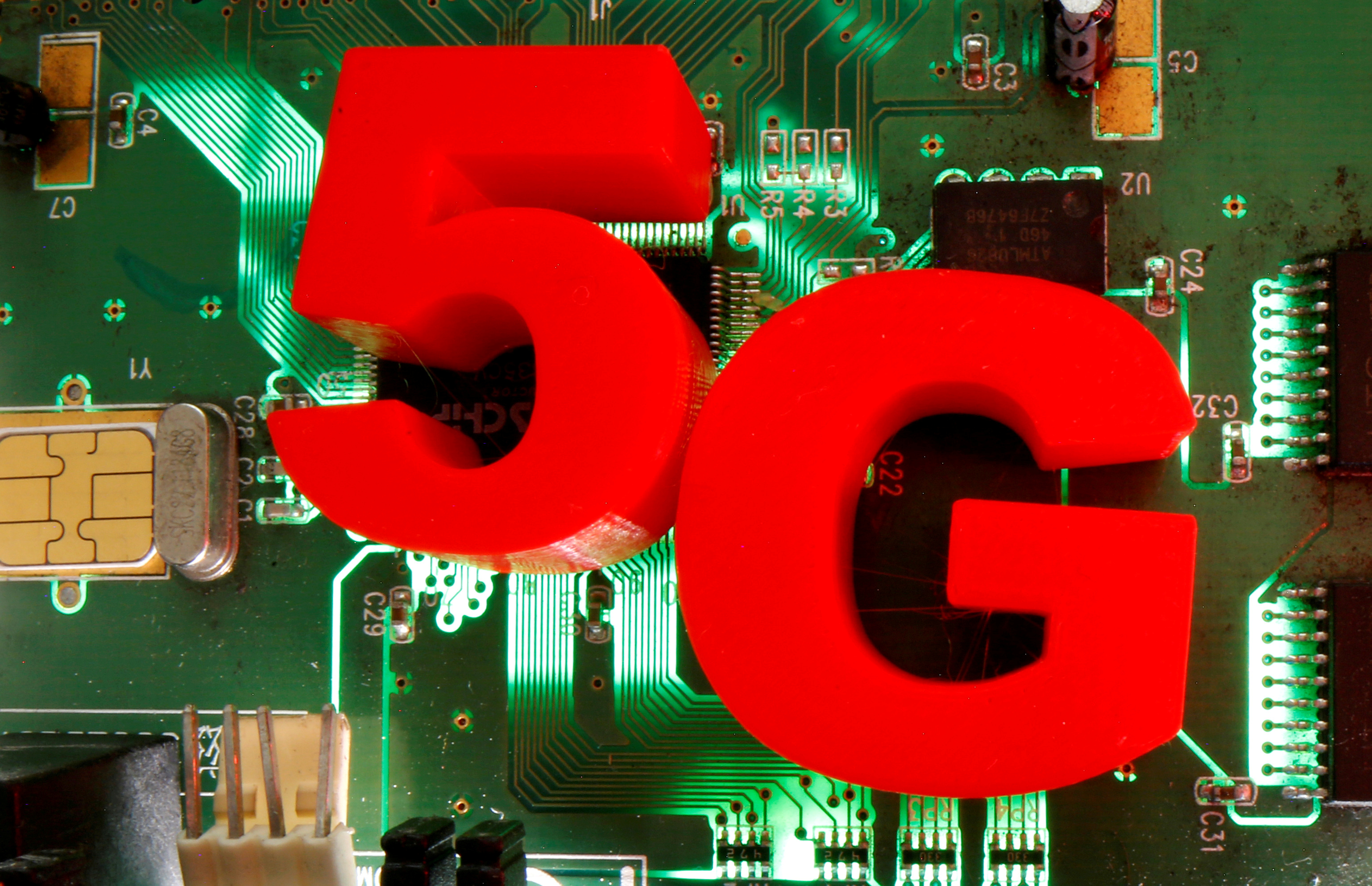 3d printed objects representing 5G are put on a motherboard in this picture illustration taken April 24, 2020. REUTERS/Dado Ruvic /Illustration